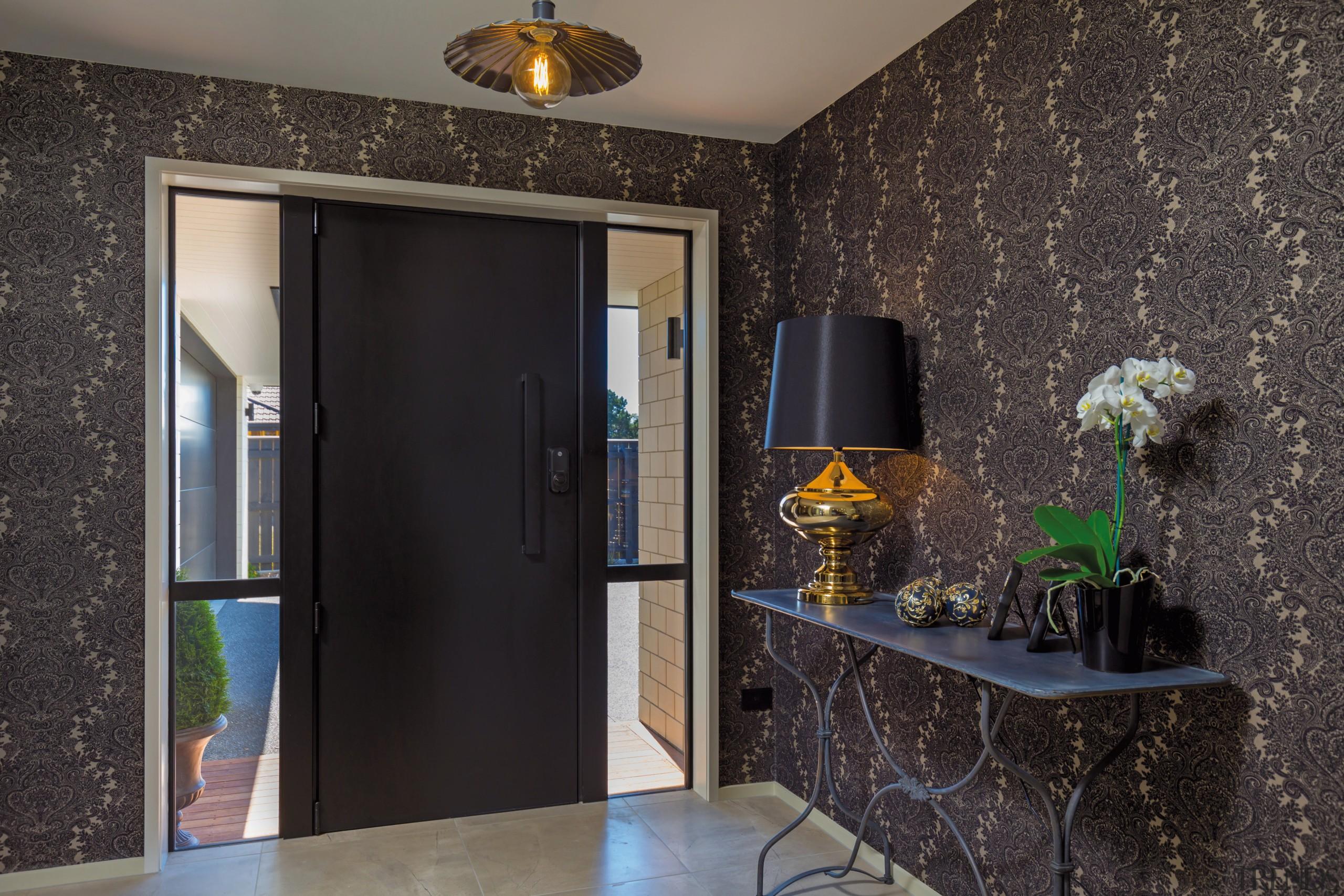 This spacious entry hall in the GJ Gardner door, floor, flooring, home, interior design, room, wall, black, gray