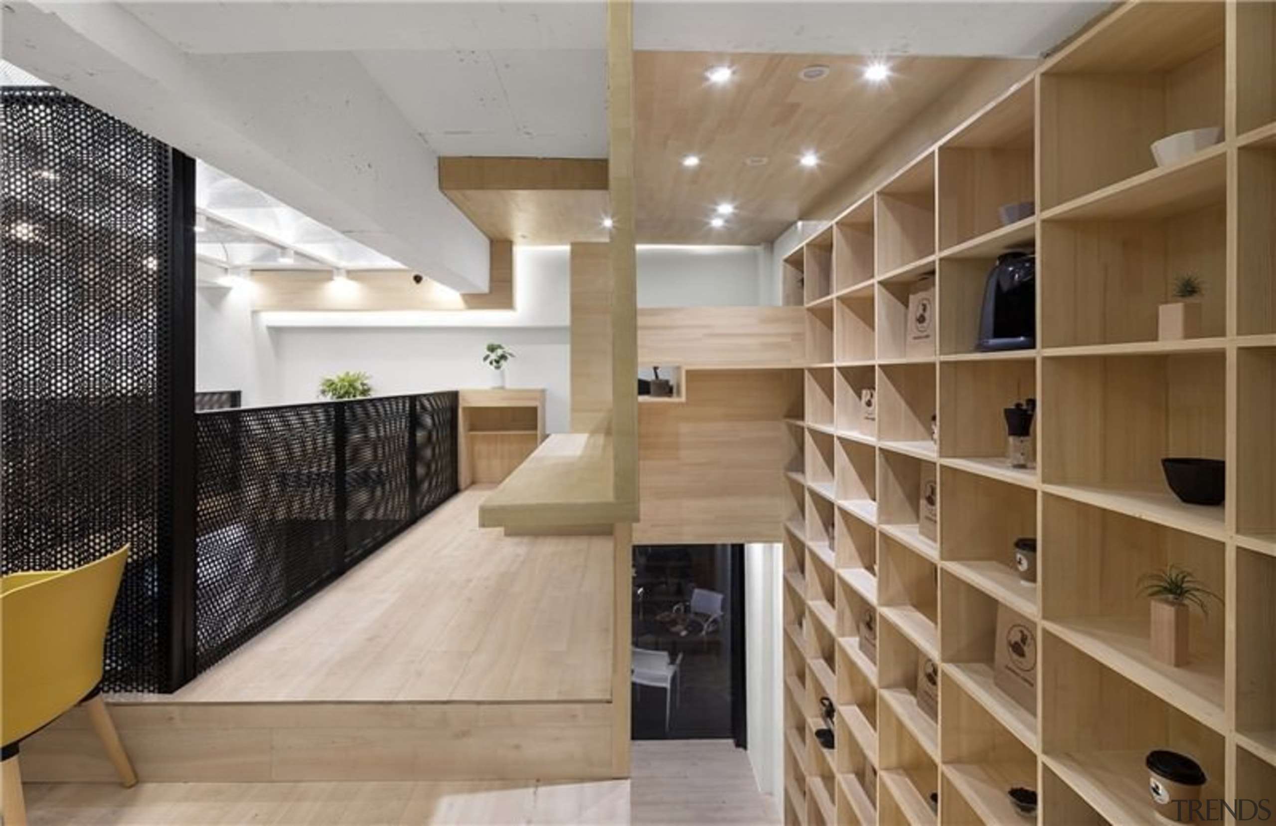The balustrade separates the two levels - The cabinetry, ceiling, closet, floor, flooring, furniture, interior design, lobby, room, shelving, brown, gray