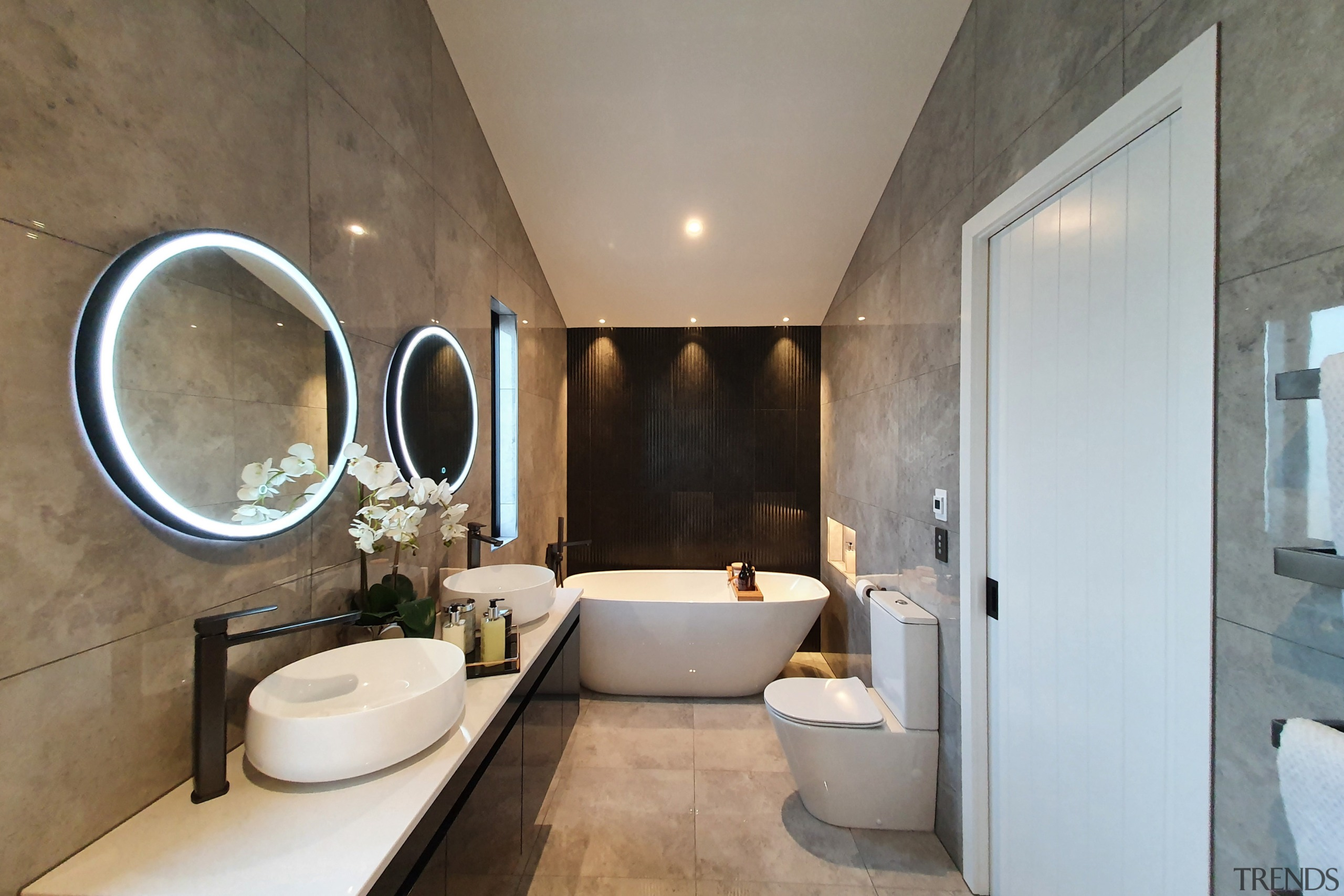 Illuminated circular mirrors add to the exotic feel