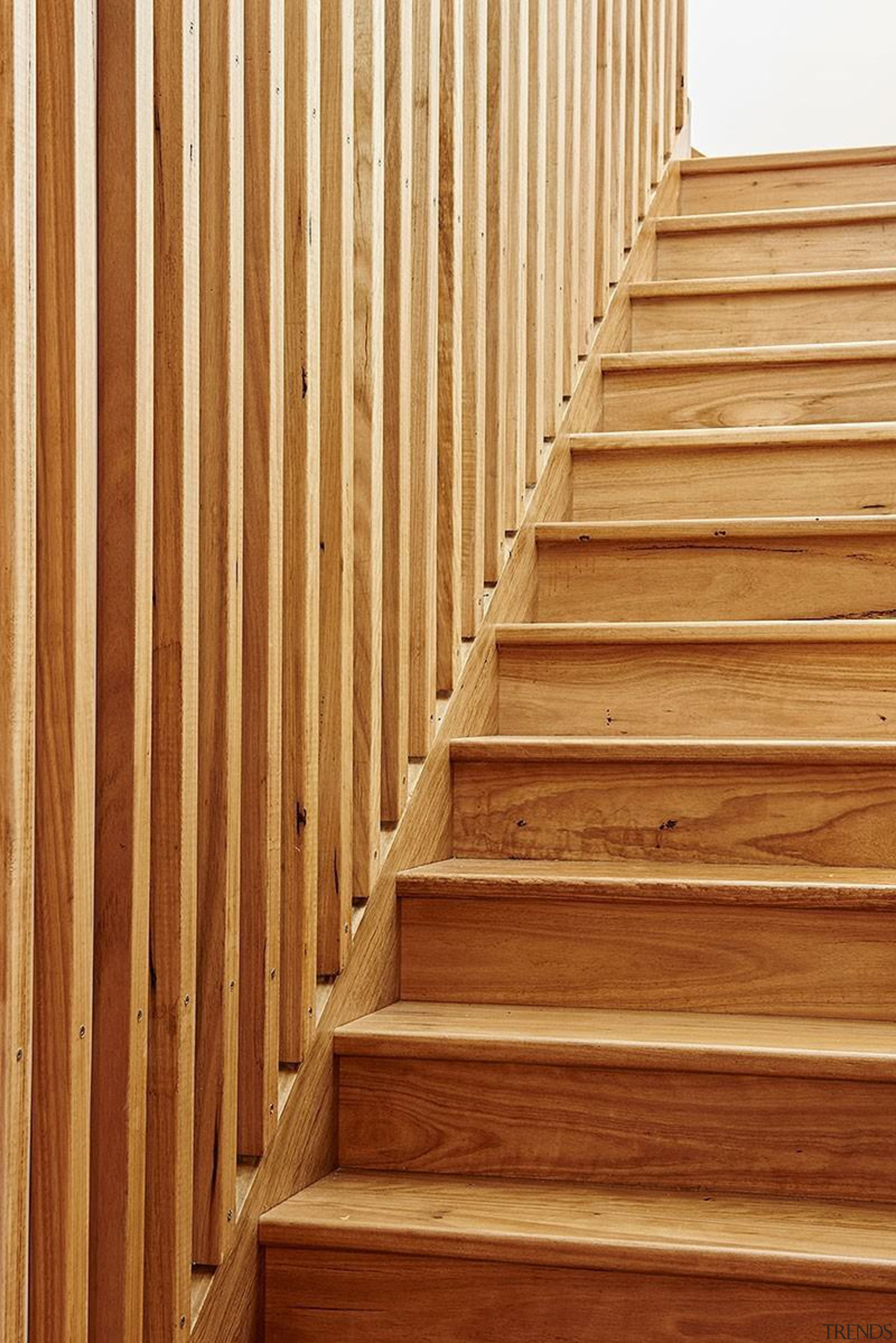 Timber is the star of the show with floor, flooring, garapa, handrail, hardwood, laminate flooring, line, lumber, plywood, stairs, wall, wood, wood flooring, wood stain, brown, orange