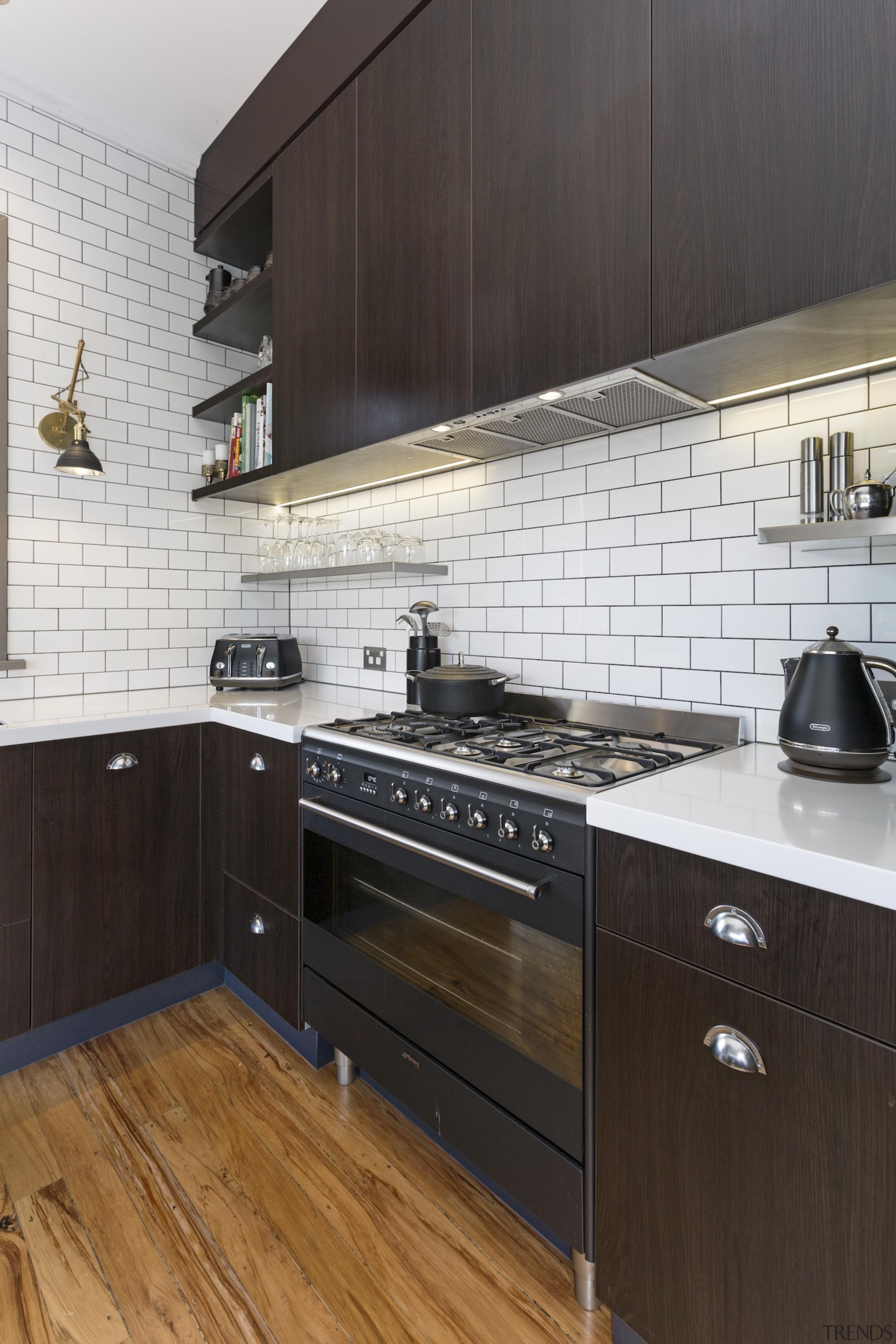 TIDA NZ 2017 – Designer kitchen entrant – cabinetry, countertop, cuisine classique, floor, flooring, hardwood, interior design, kitchen, kitchen stove, property, room, tile, wood flooring, black, white