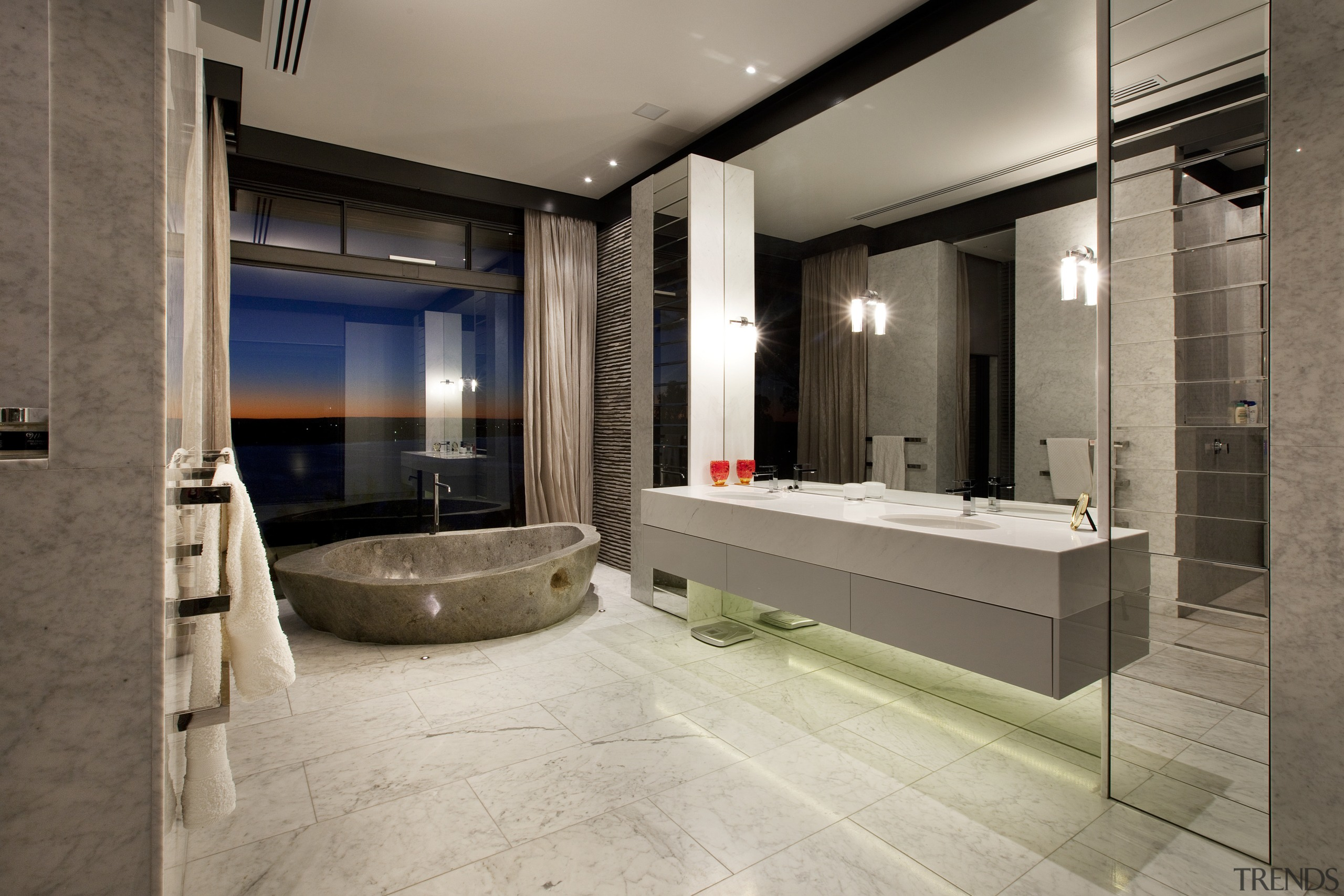 This house was designed by architect Martin Grounds bathroom, floor, flooring, interior design, lobby, room, tile, gray, brown
