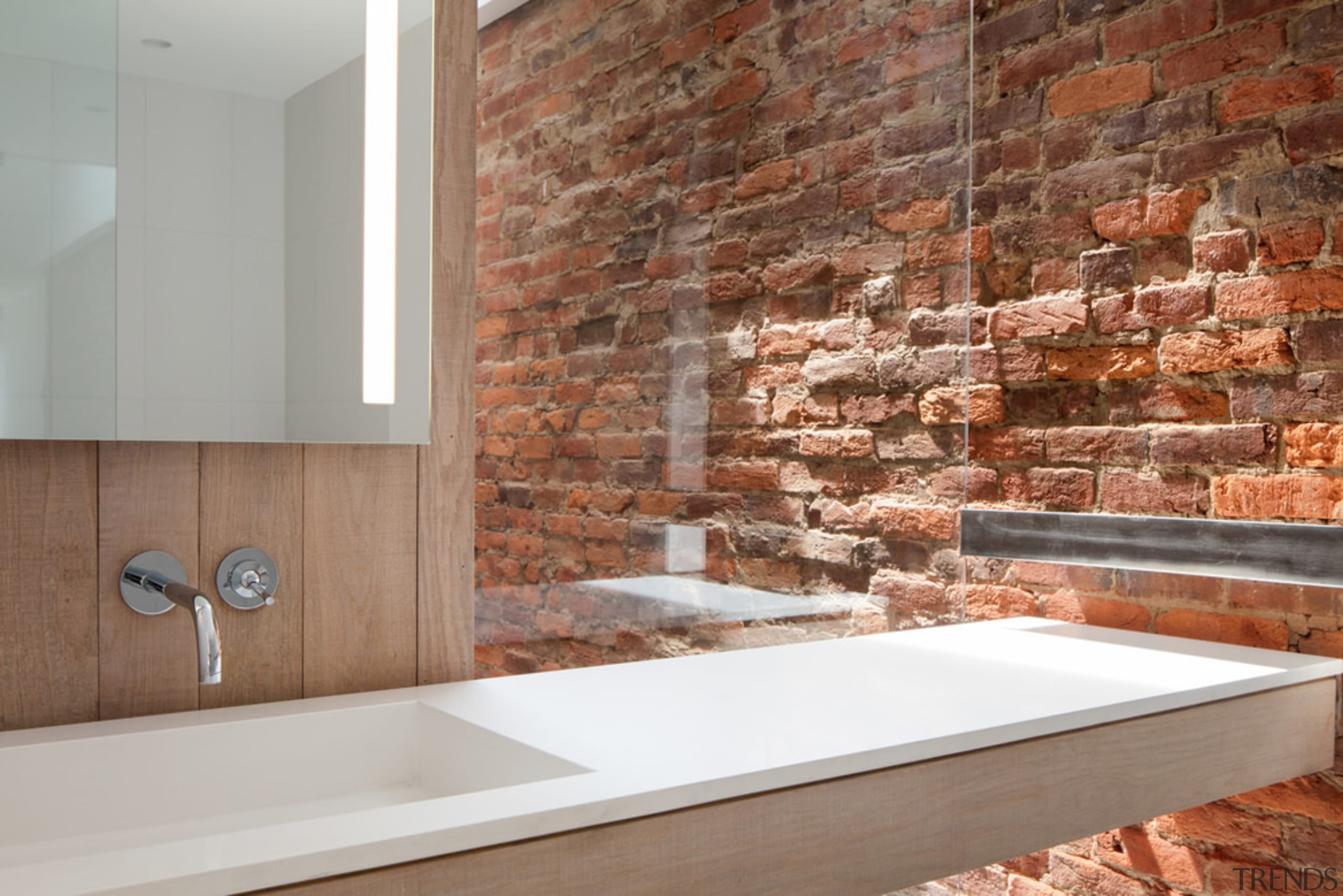 Throughout the apartment, bathroom included, the building's rugged
