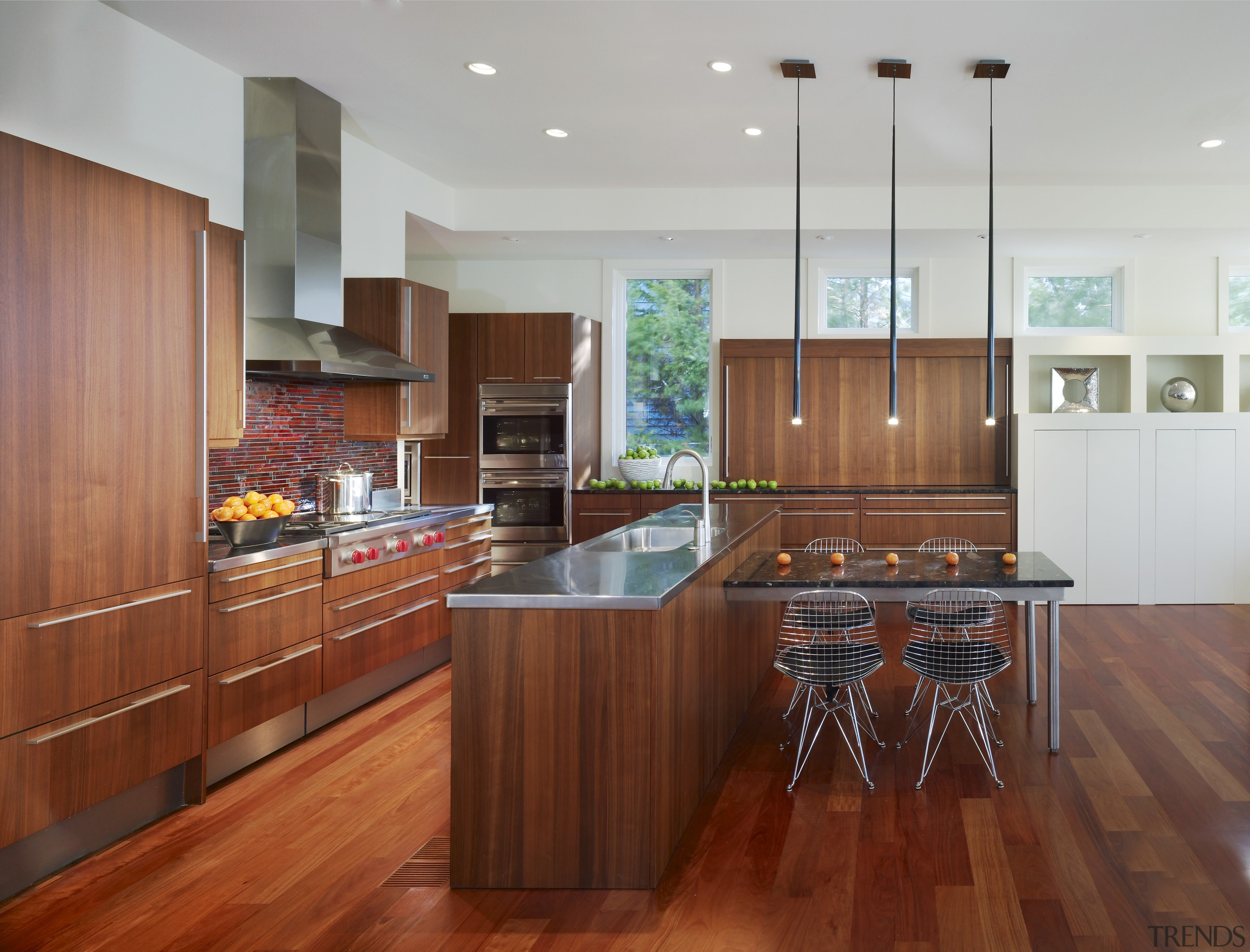 View of a kitchen which combines commerical touches cabinetry, countertop, cuisine classique, floor, flooring, hardwood, interior design, kitchen, laminate flooring, real estate, room, wood, wood flooring, gray, red