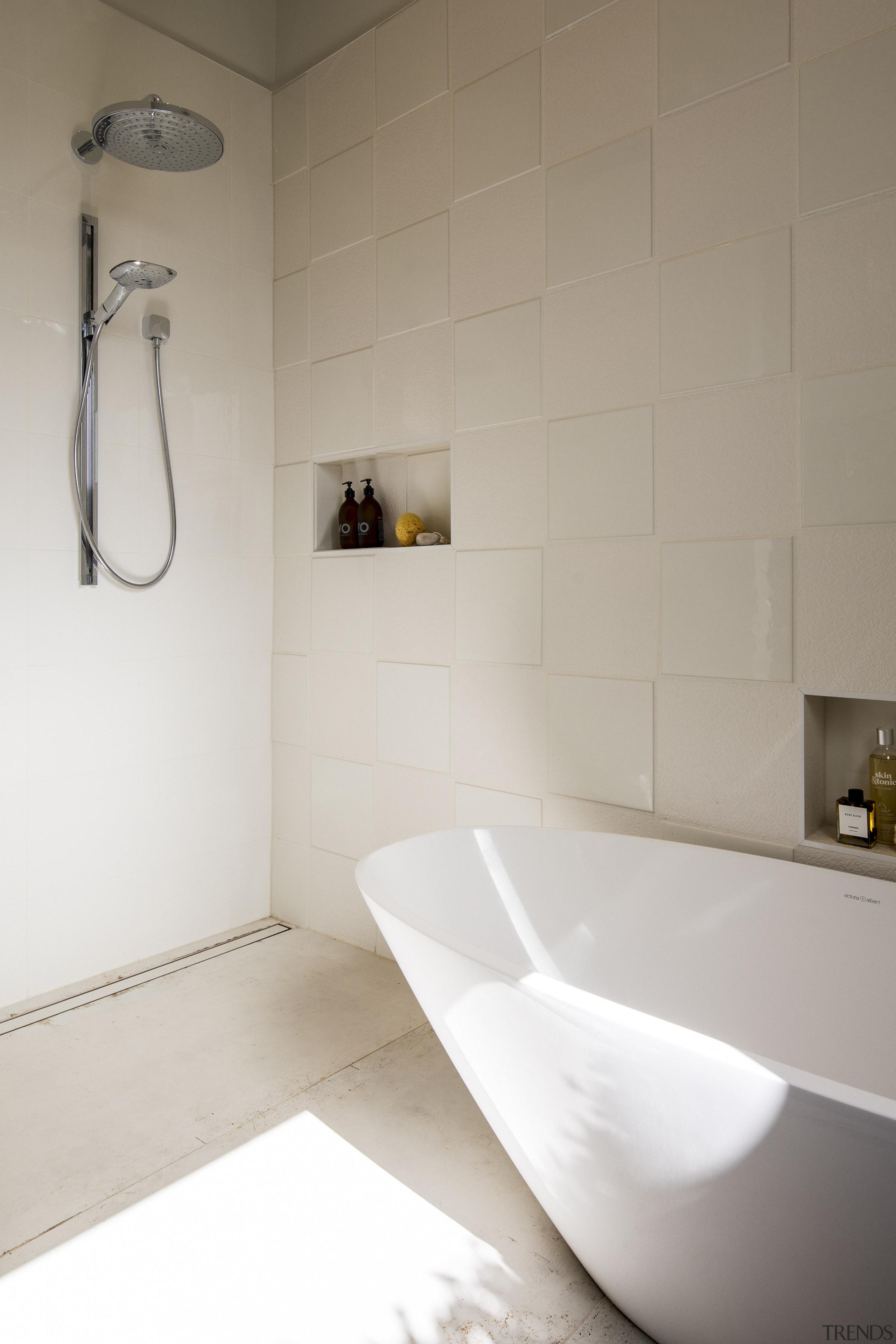 A strip drain ensures speedy drainage in the bathroom, ceramic, floor, flooring, interior design, plumbing fixture, product design, room, sink, tap, tile, wall, gray