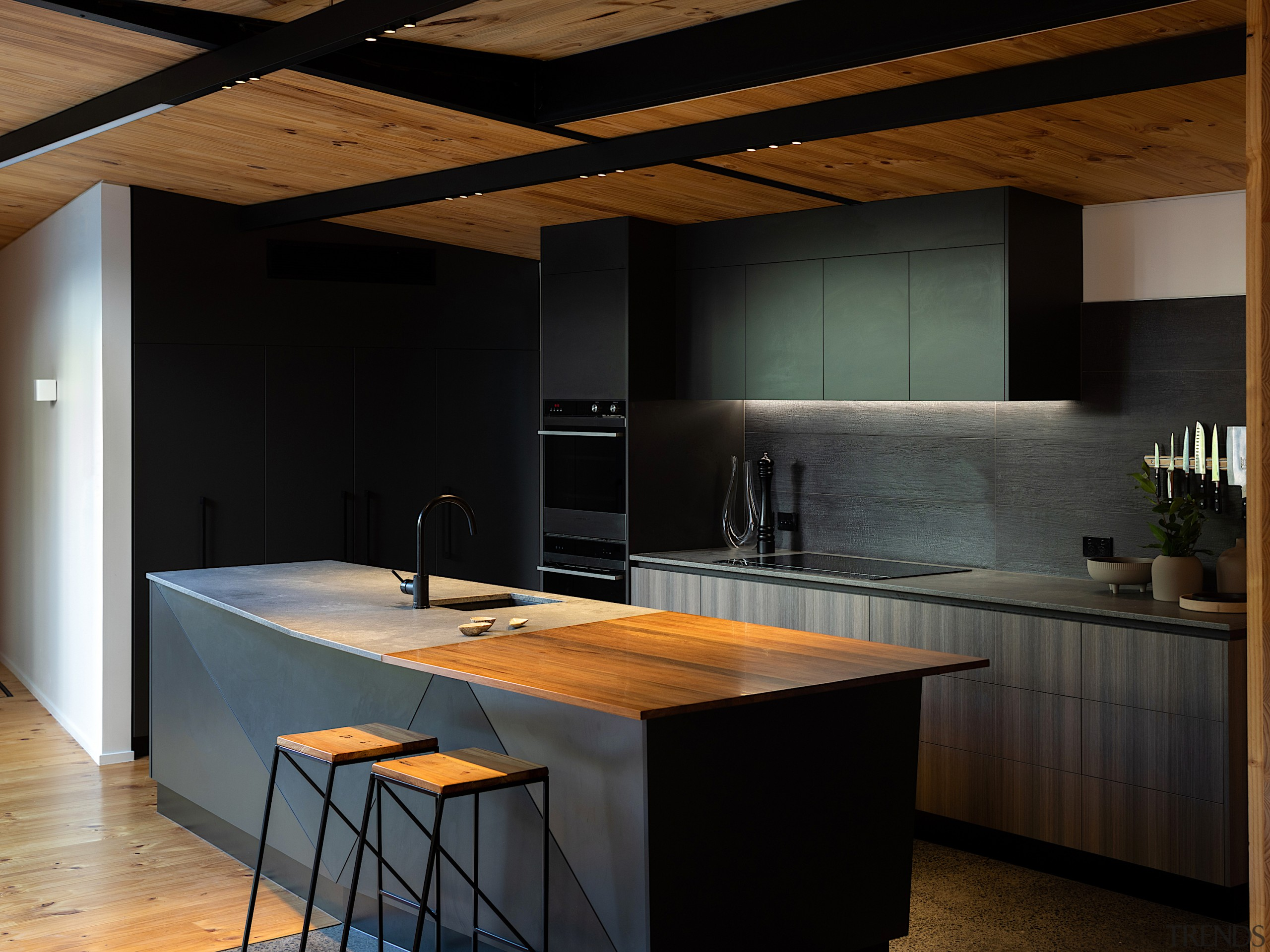 The kitchen's fractured forms reflect the exterior's western black