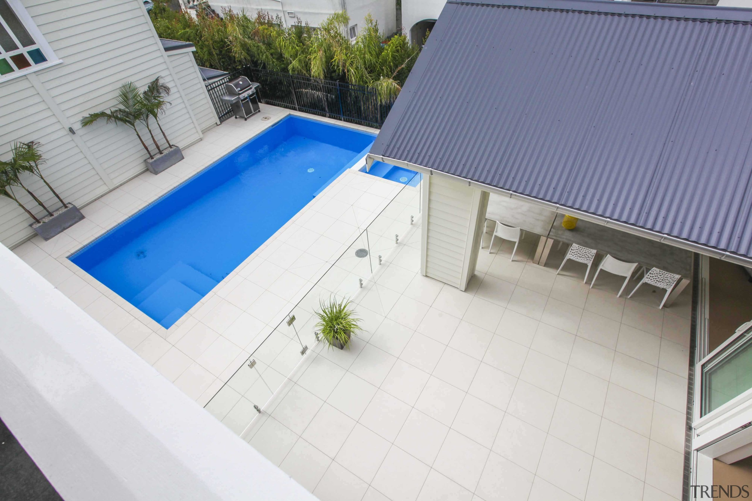 A glass balustrade prevents unwanted access to the architecture, area, daylighting, home, house, property, real estate, residential area, roof, swimming pool, window, white