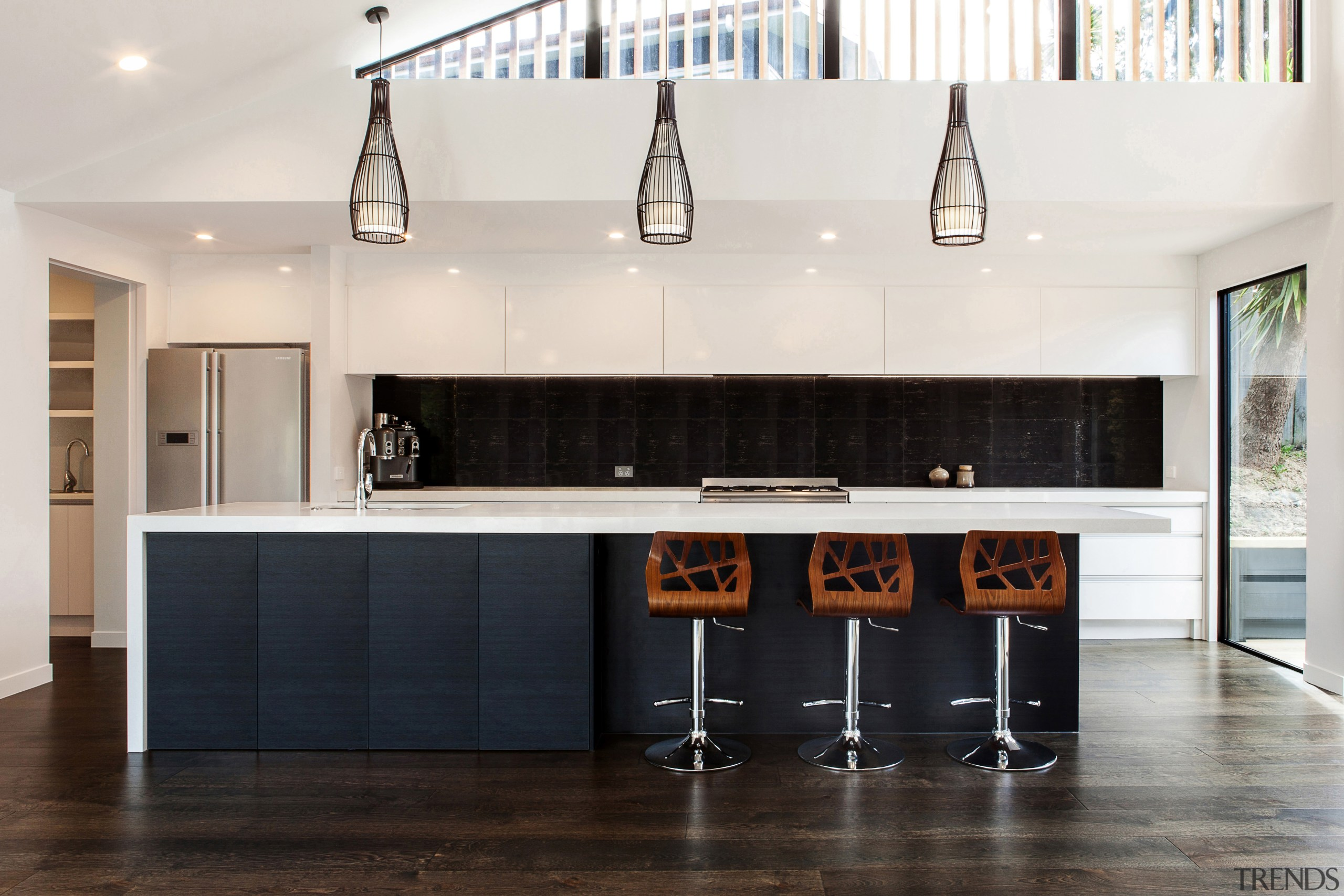 Dark wood veneer contrasts high-gloss white lacquer in cabinetry, countertop, cuisine classique, floor, flooring, furniture, interior design, kitchen, room, white, black
