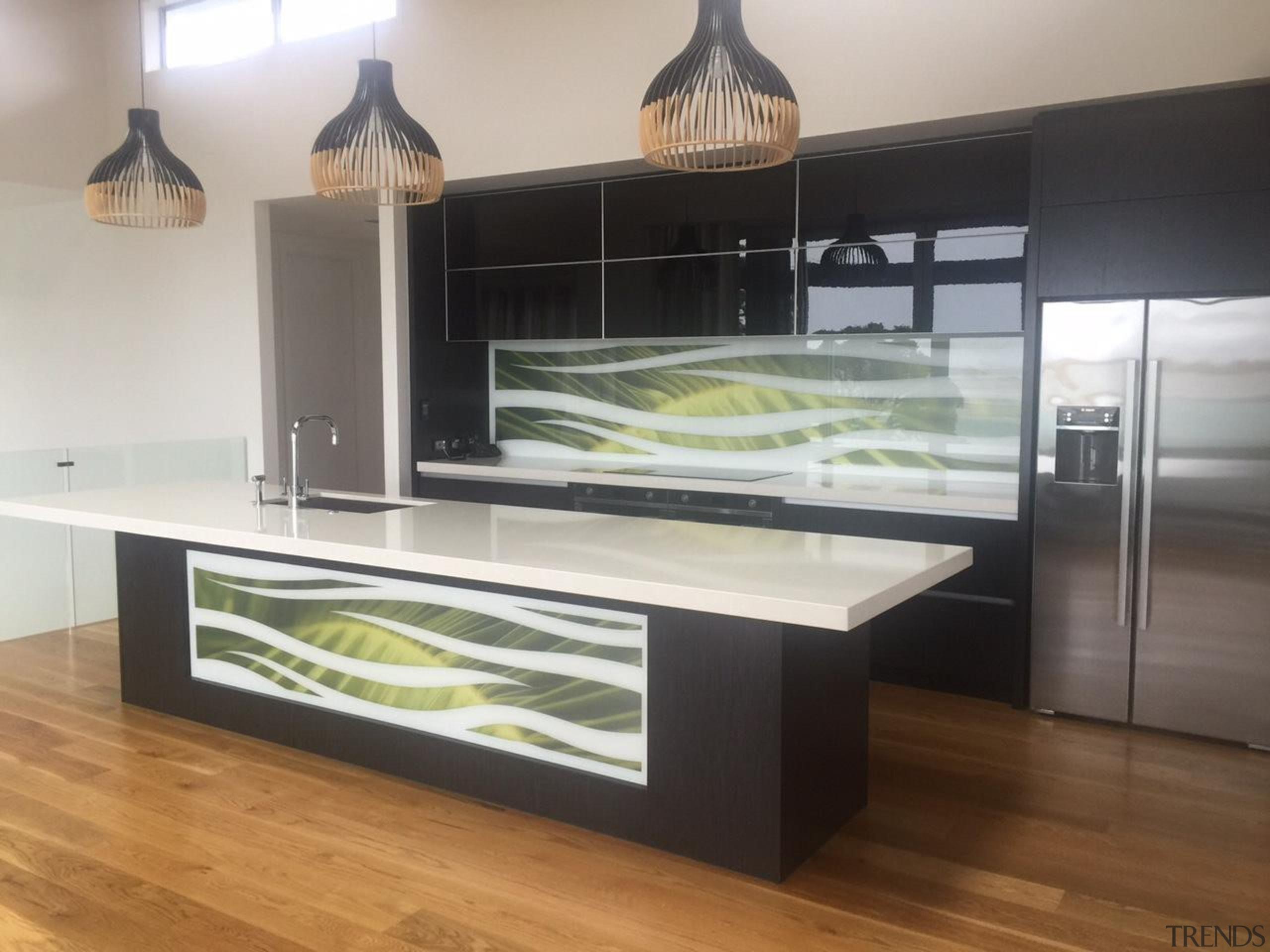 Colourful glass splashbacks create a dynamic backdrop in countertop, furniture, glass, kitchen, gray