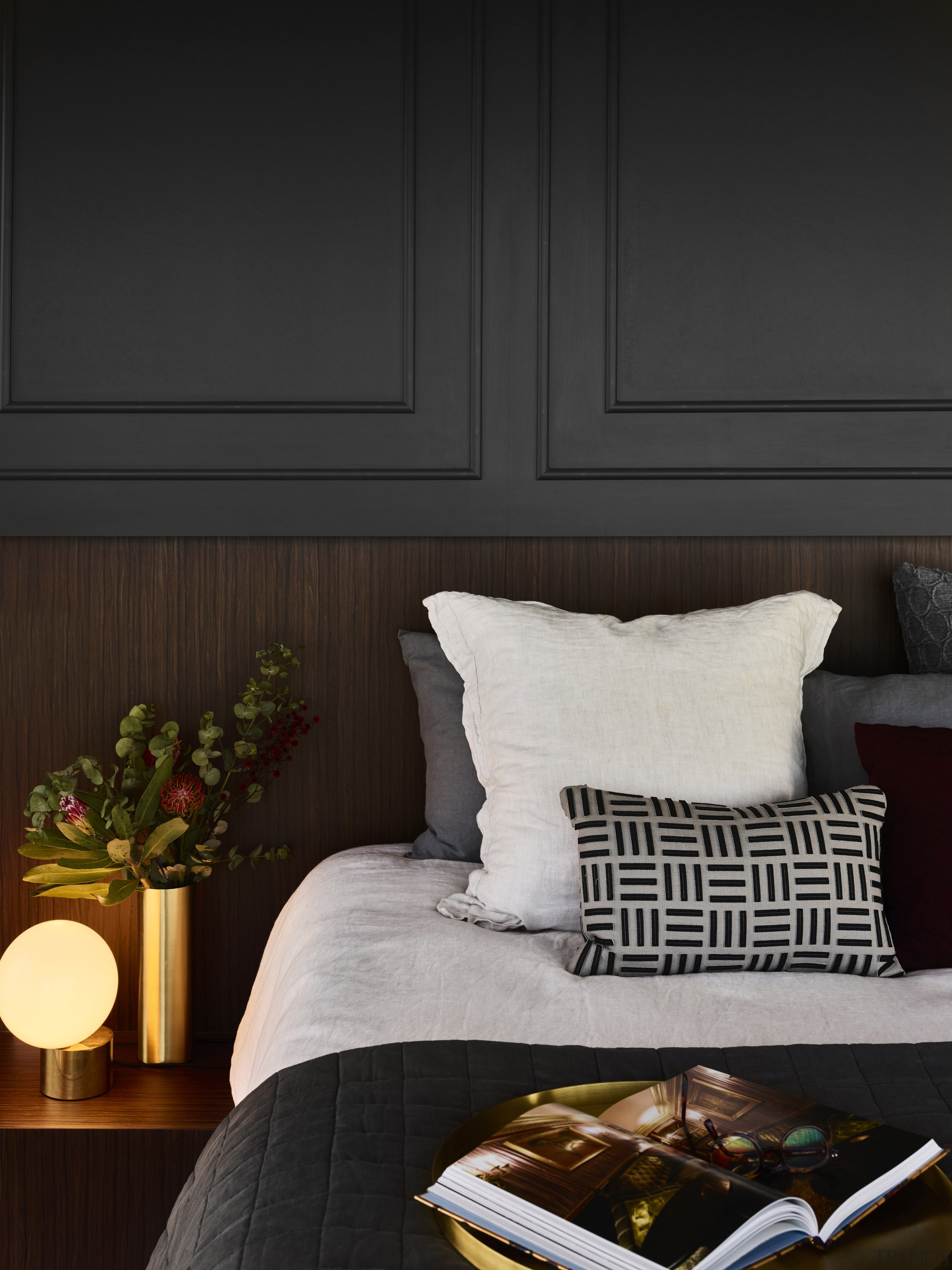 Catering to the owners' desire for a pampered bed, bed frame, bed sheet, bedding, bedroom, black, brown, comfort, cushion, design, duvet cover, floor, furniture, hardwood, home, house, interior design, lighting, nightstand, pillow, room, textile, wall, wood, black
