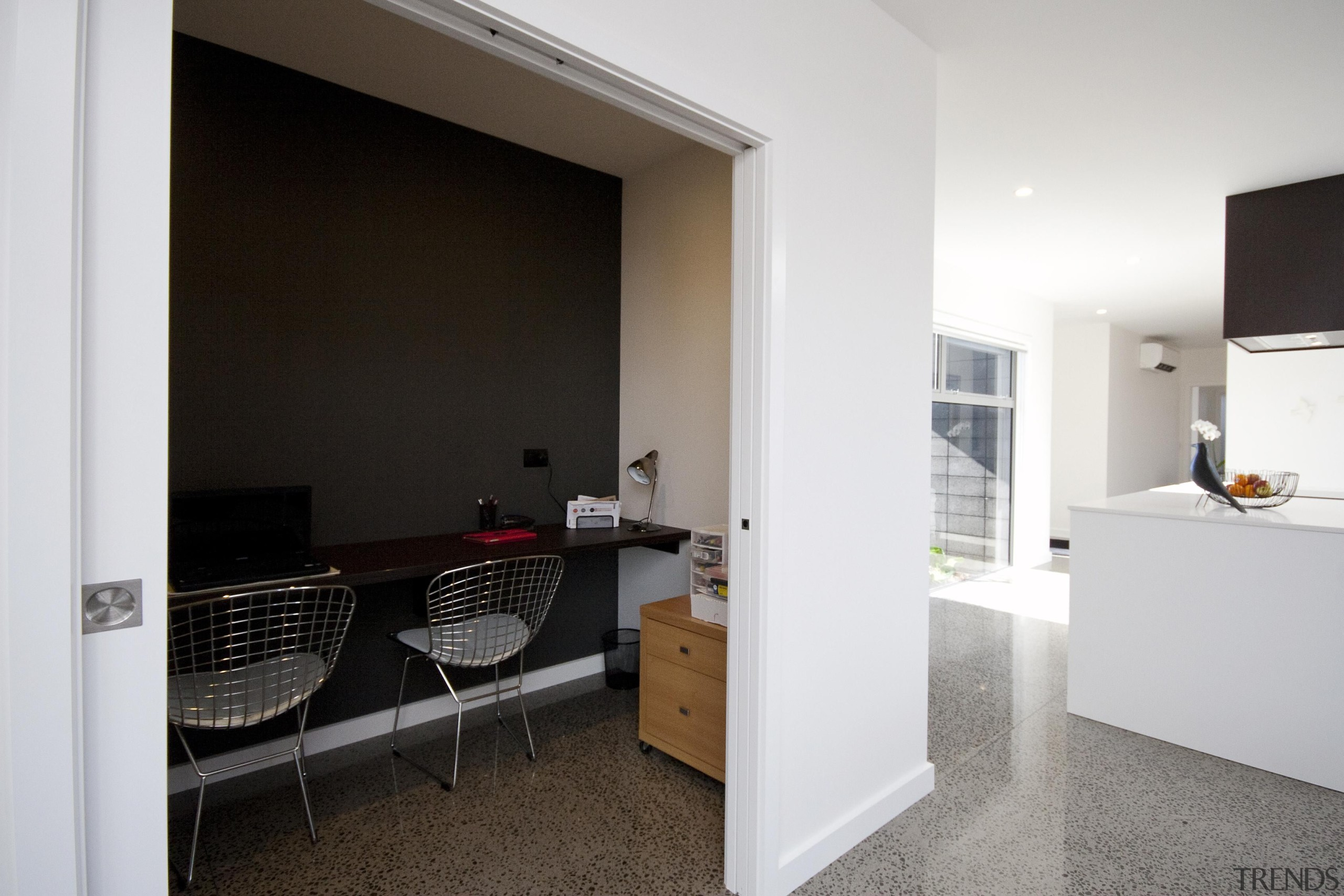 Office nook off the living area, a convenient apartment, door, floor, flooring, home, house, interior design, property, real estate, room, white, black