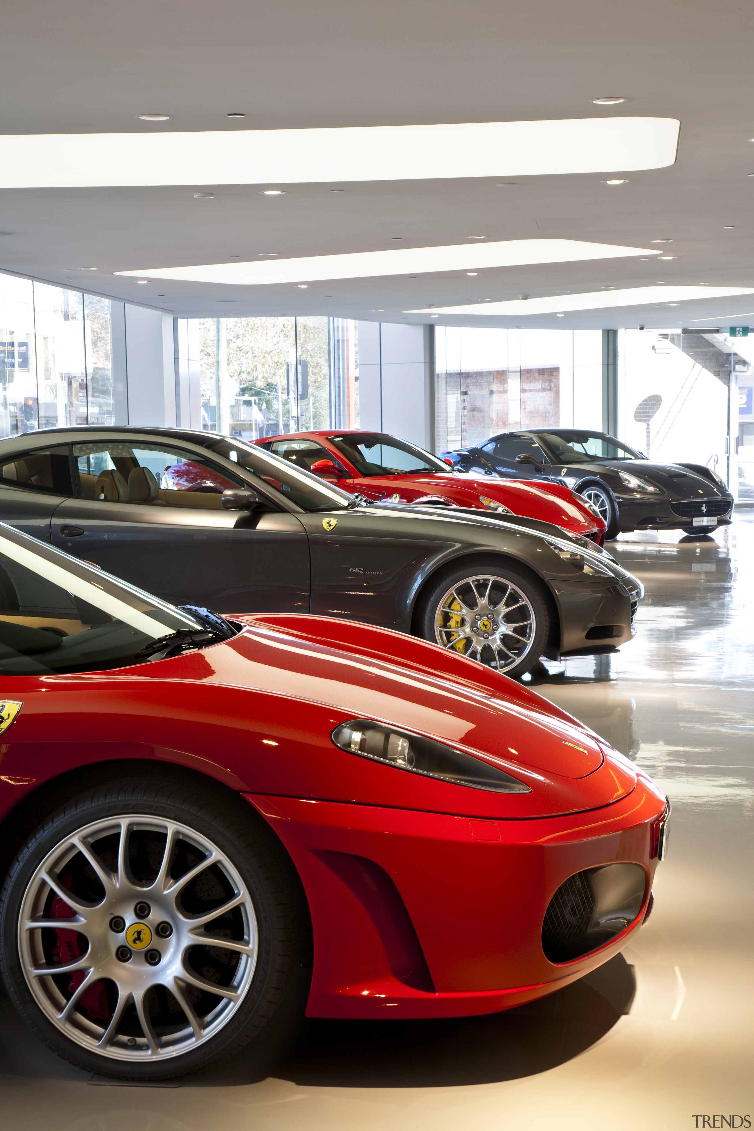 Ferrari Showroom in Australia - Ferrari Showroom in automotive design, automotive exterior, automotive wheel system, car, ferrari f430, ferrari f430 challenge, land vehicle, luxury vehicle, motor vehicle, performance car, race car, red, sports car, supercar, vehicle, wheel, white