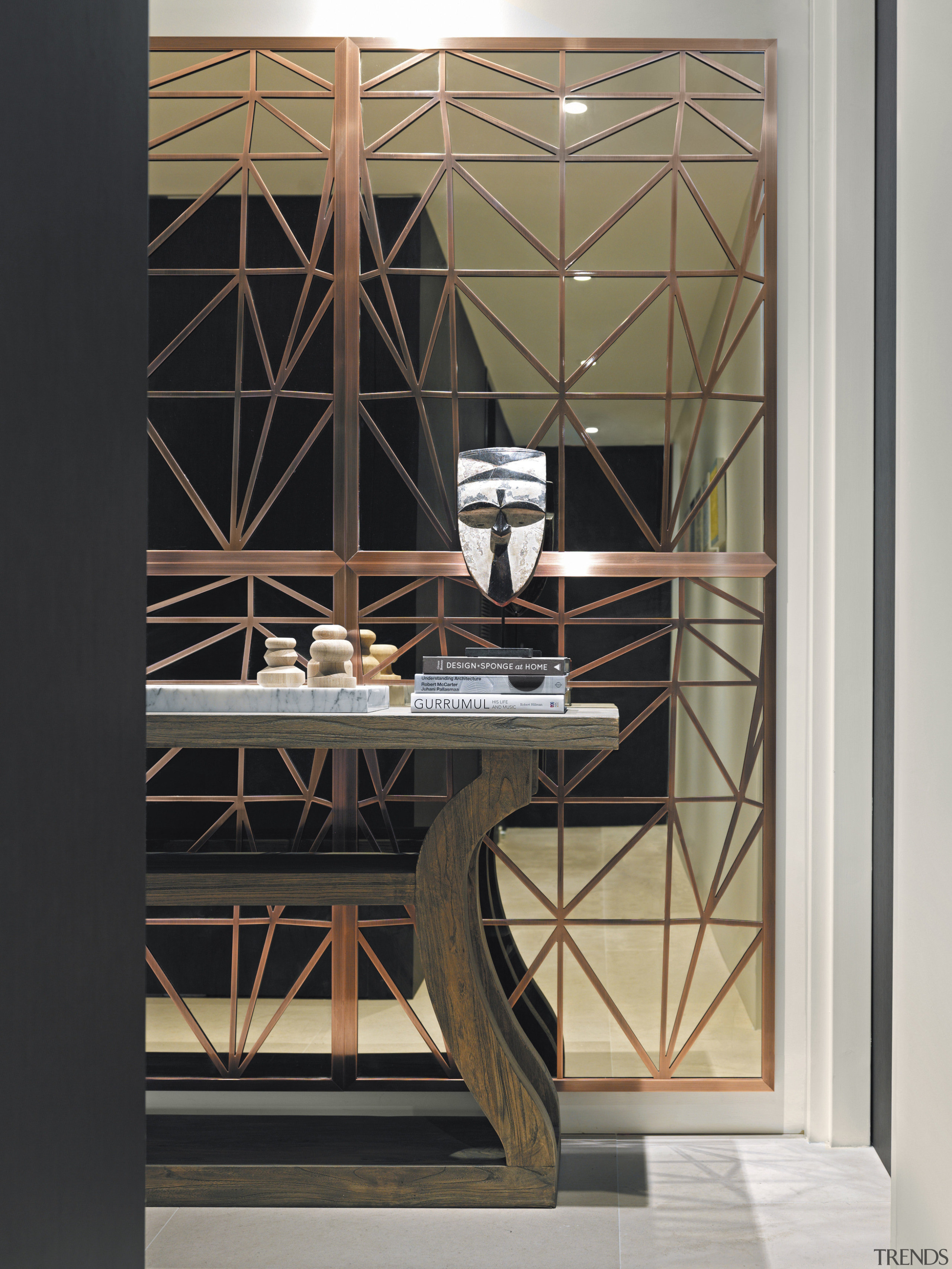 A mirrored wall and console features in the furniture, product design, shelf, shelving, black, gray
