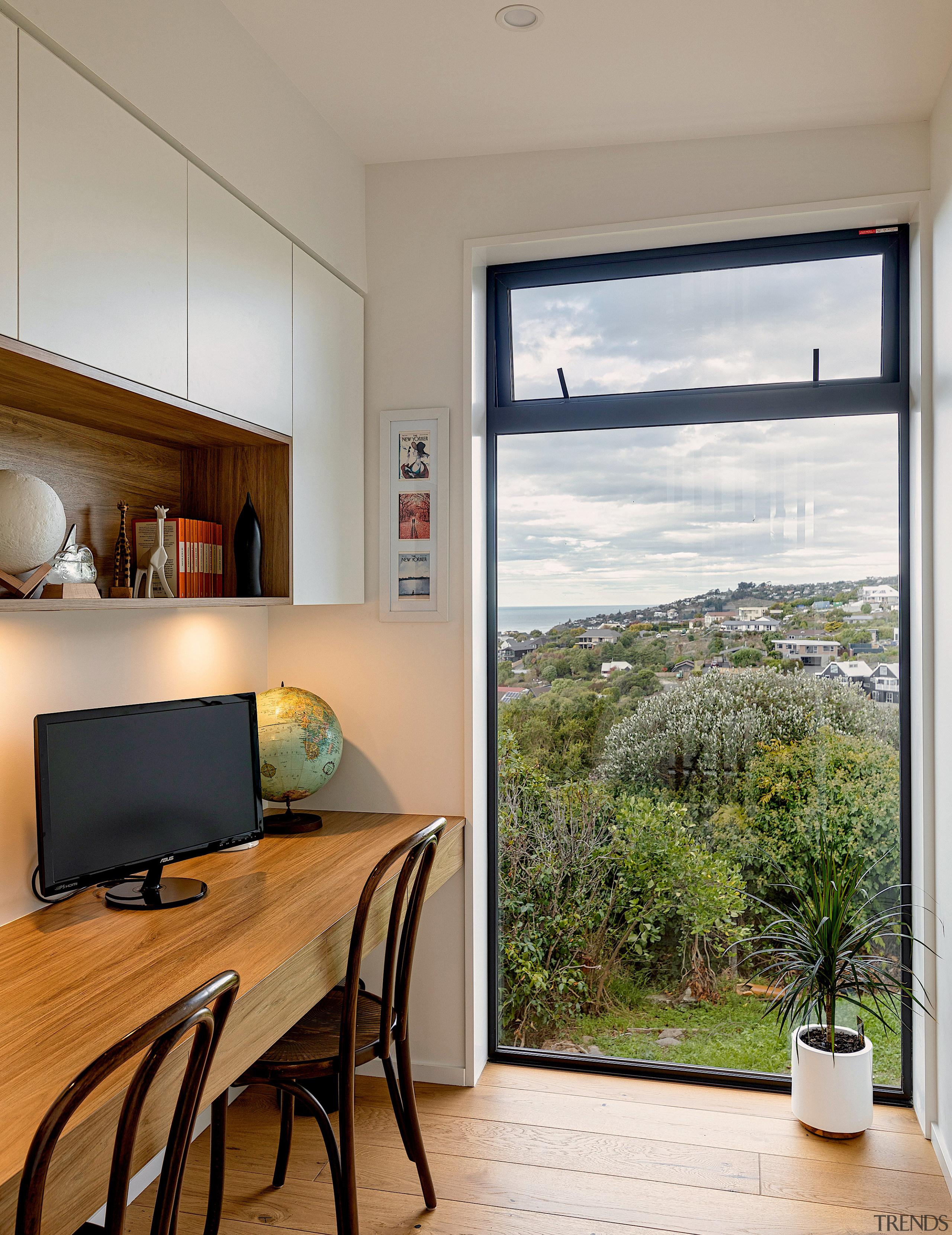 Floor-to-near-ceiling windows ensure ancillary spaces get their fair