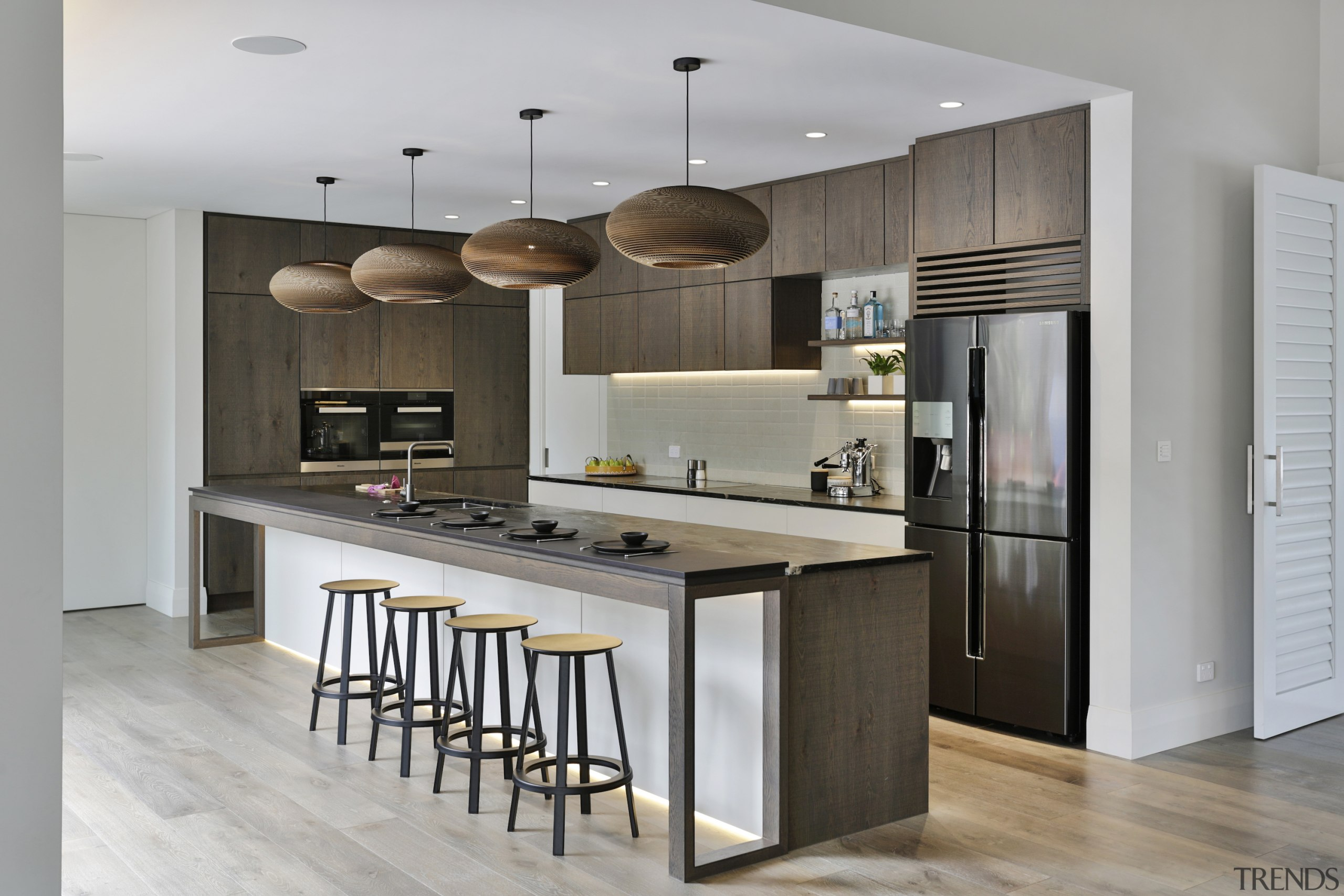 The designer specified textured oak cabinetry finishes, with