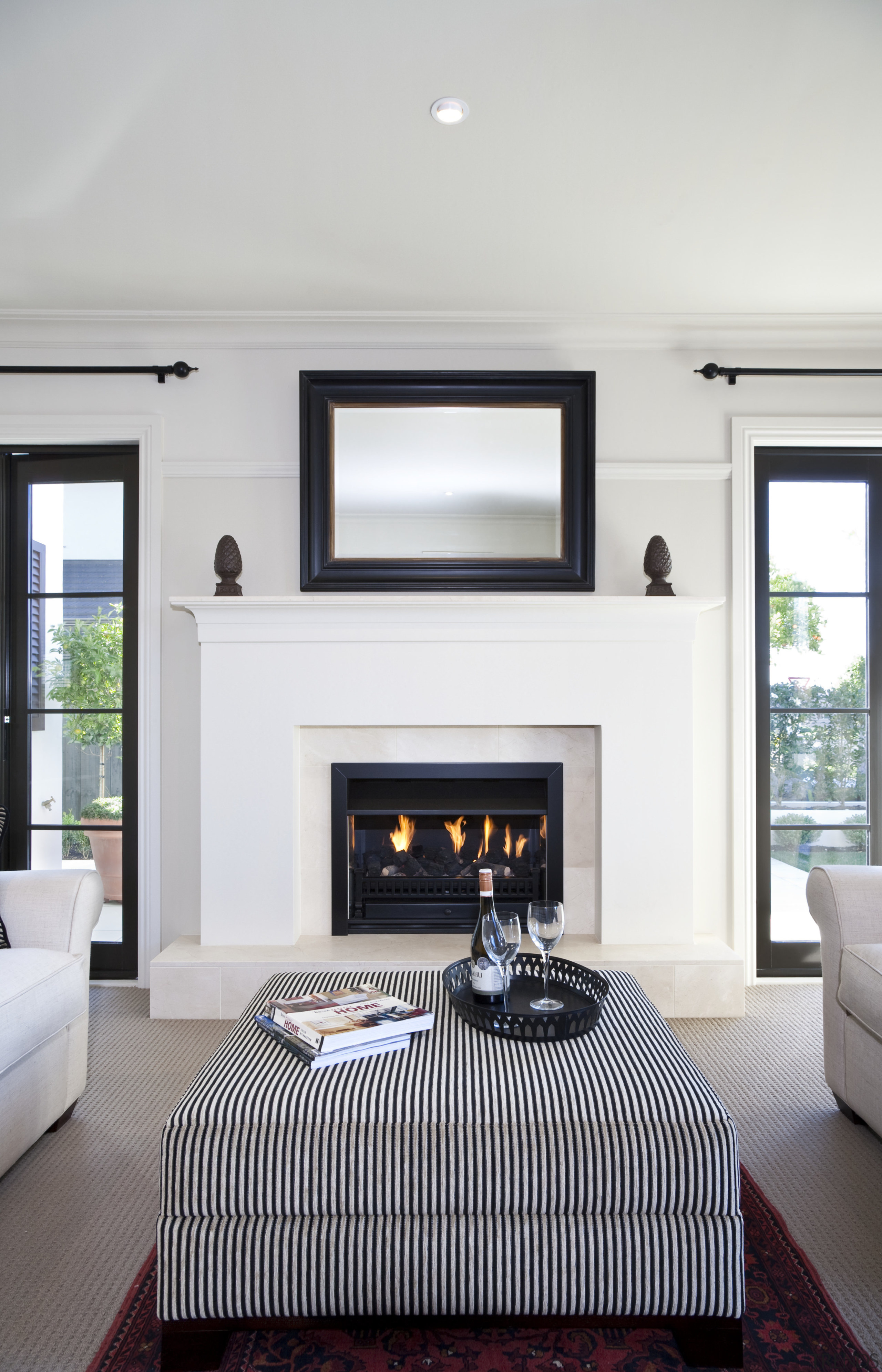 View of the lounge area which features sofas, ceiling, fireplace, floor, hearth, home, interior design, living room, room, window, white