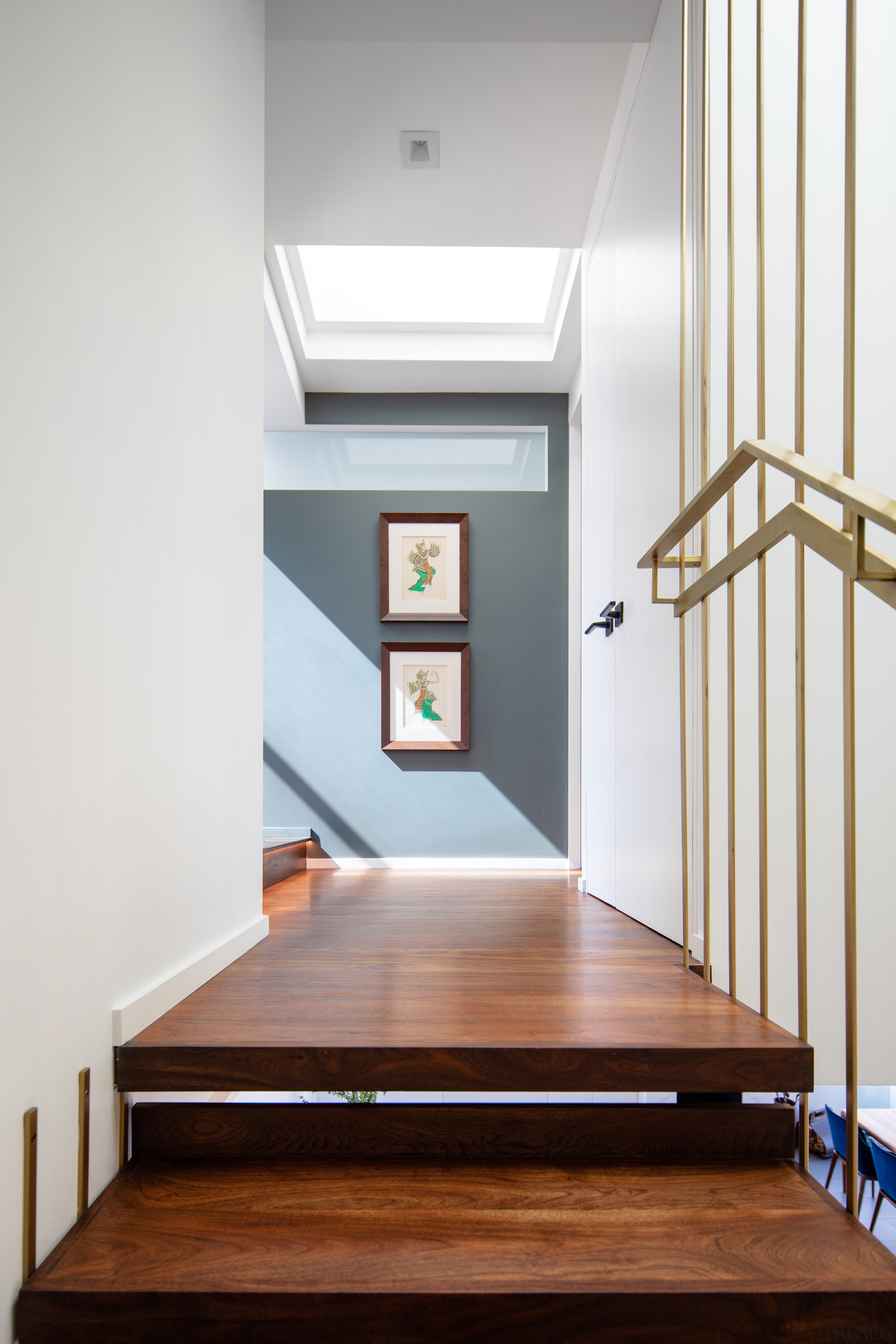 ​​​​​​​A skylight floods light into the top of architecture, baluster, design, floor, flooring, handrail, hardwood, Andrew Wilkinson
