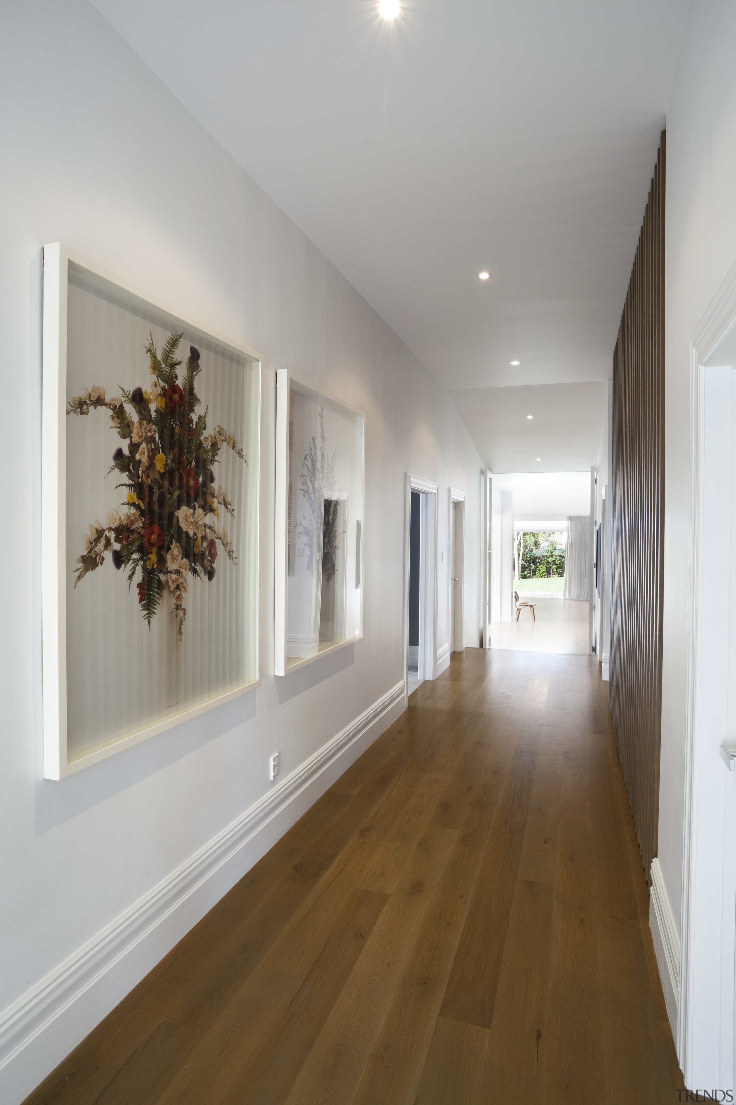 Hallway with wall art. - Renovated and modernised apartment, ceiling, daylighting, floor, flooring, hall, hardwood, home, house, interior design, laminate flooring, living room, property, real estate, room, wall, window, wood, wood flooring, gray, brown