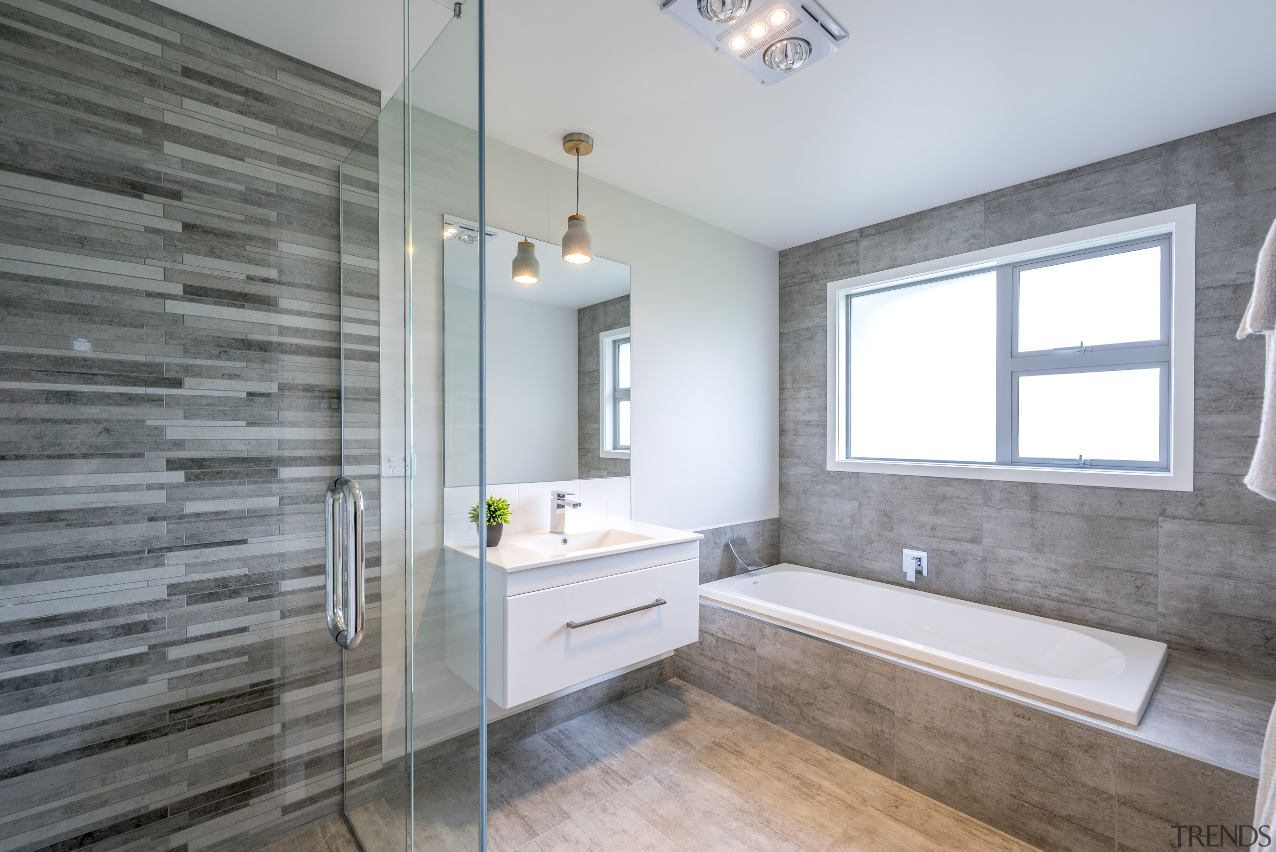 This master ensuite has feature tiles and a architecture, bathroom, daylighting, estate, floor, flooring, home, interior design, real estate, room, tile, window, gray