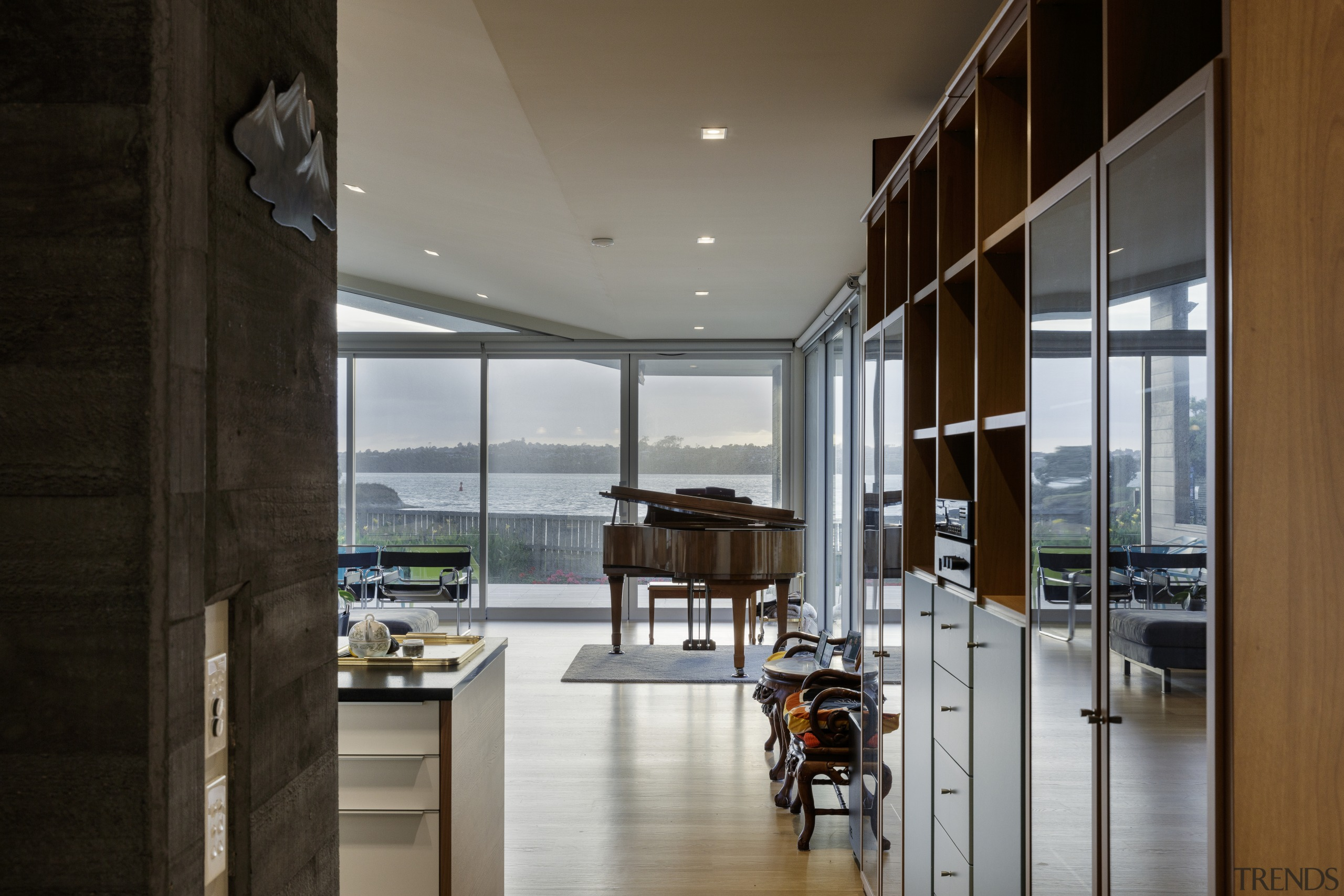 The distinctive, individual house responds sensitively to the apartment, architecture, building, ceiling, daylighting, door, floor, flooring, furniture, glass, home, house, interior design, loft, property, real estate, room, table, window, black, gray