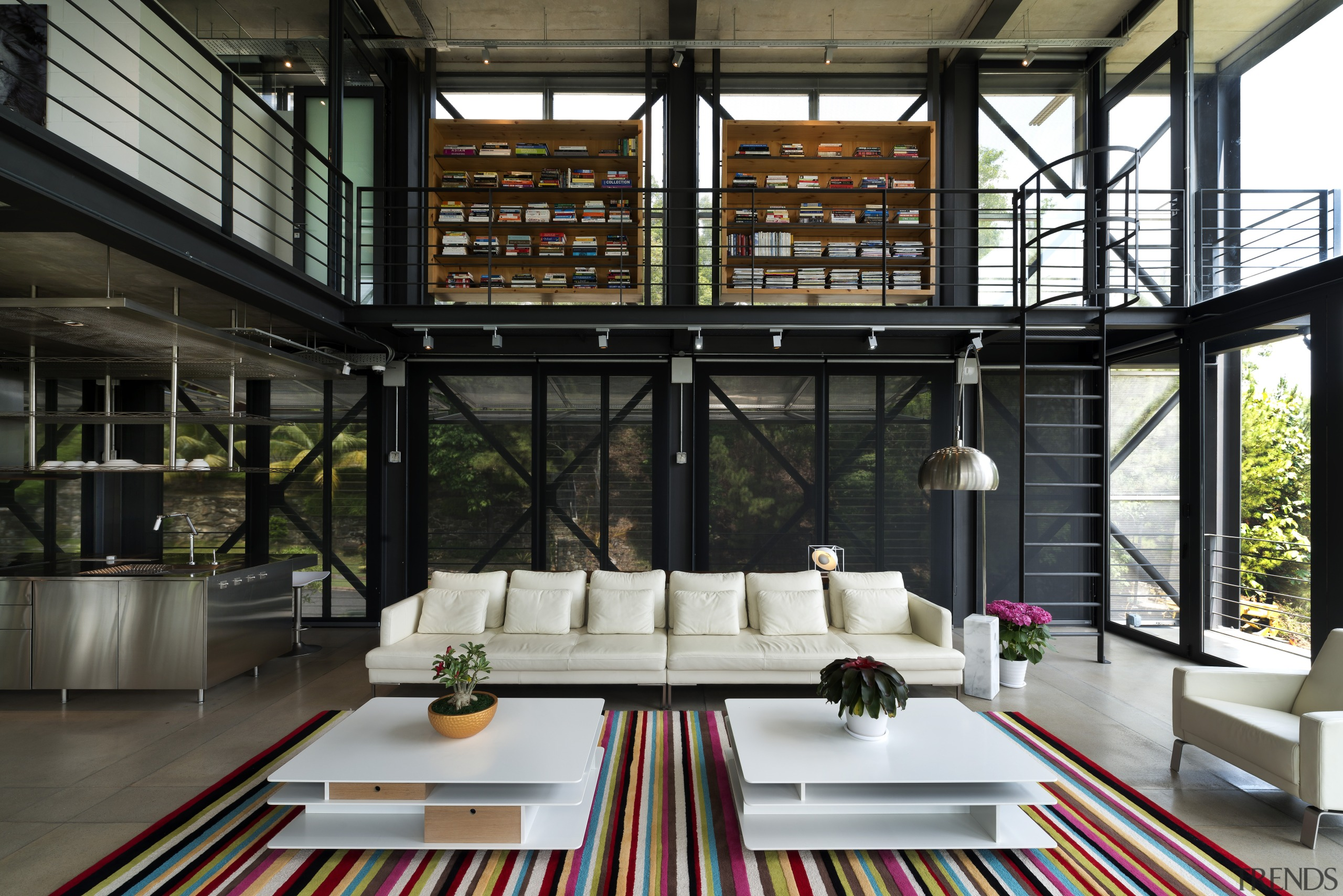 This double-height living area has a walkway and daylighting, interior design, living room, window, black