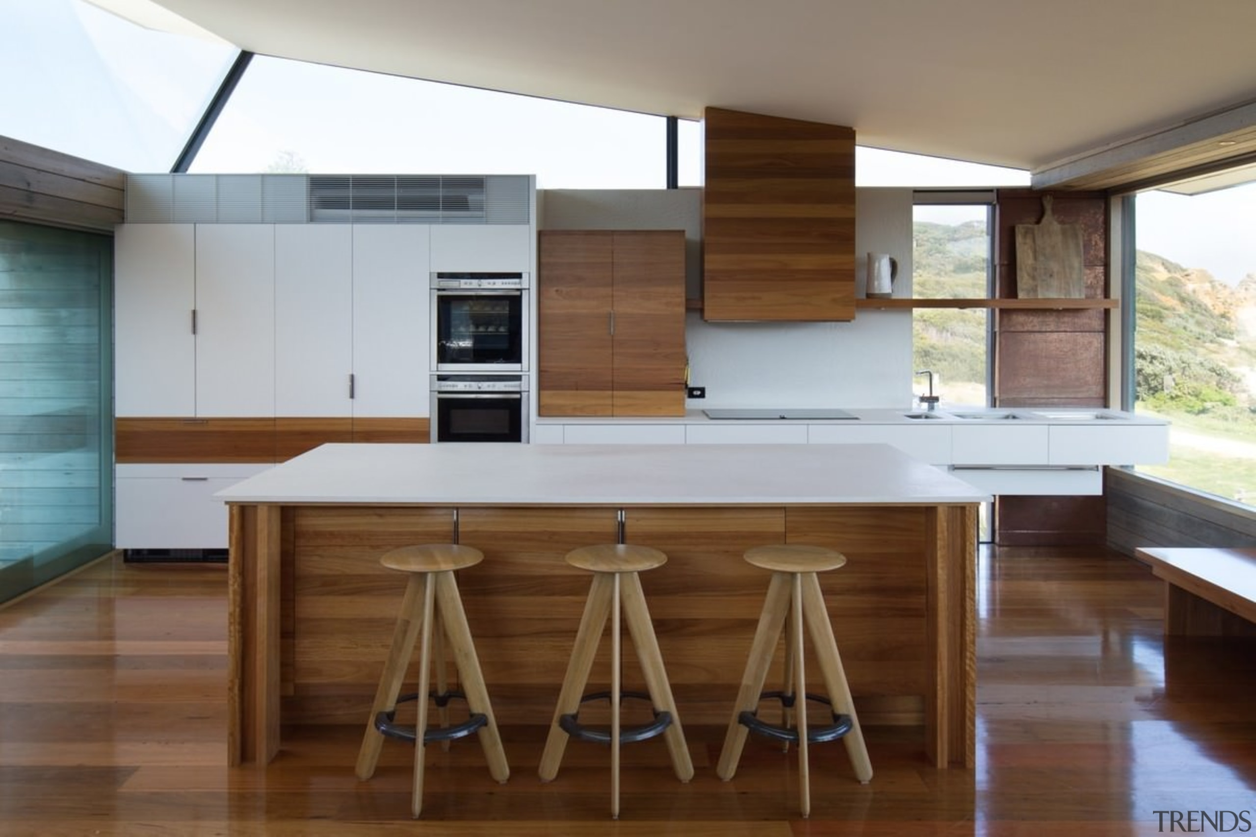 The centrepiece of this kitchen is definitely the architecture, countertop, floor, flooring, hardwood, house, interior design, kitchen, real estate, table, wood, wood flooring, brown, gray