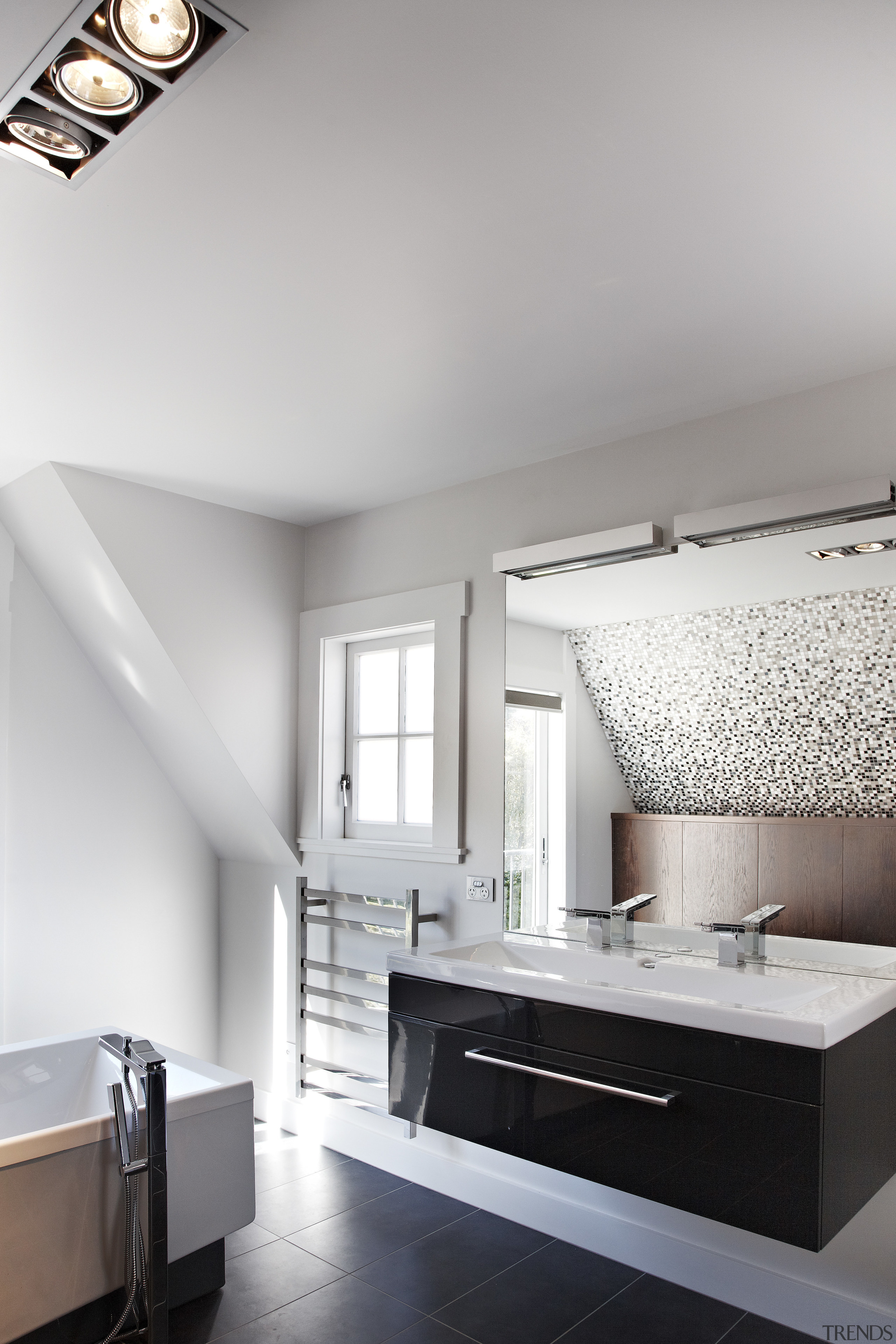 The houses architecture echoes the existing Arts and architecture, bathroom, ceiling, daylighting, floor, home, interior design, room, sink, tap, wall, gray, white