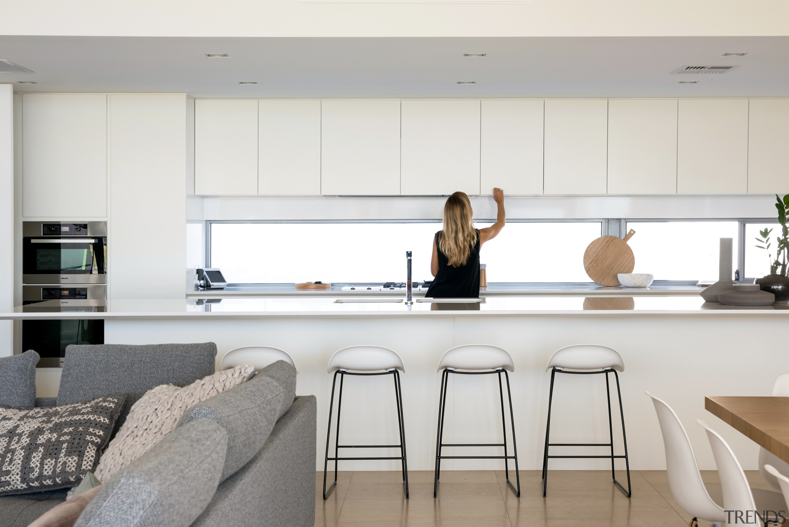 The all white kitchen provides a neutral backdrop building, ceiling, countertop, design, dining room, floor, flooring, furniture, home, house, interior design, kitchen, living room, material property, property, room, table, white