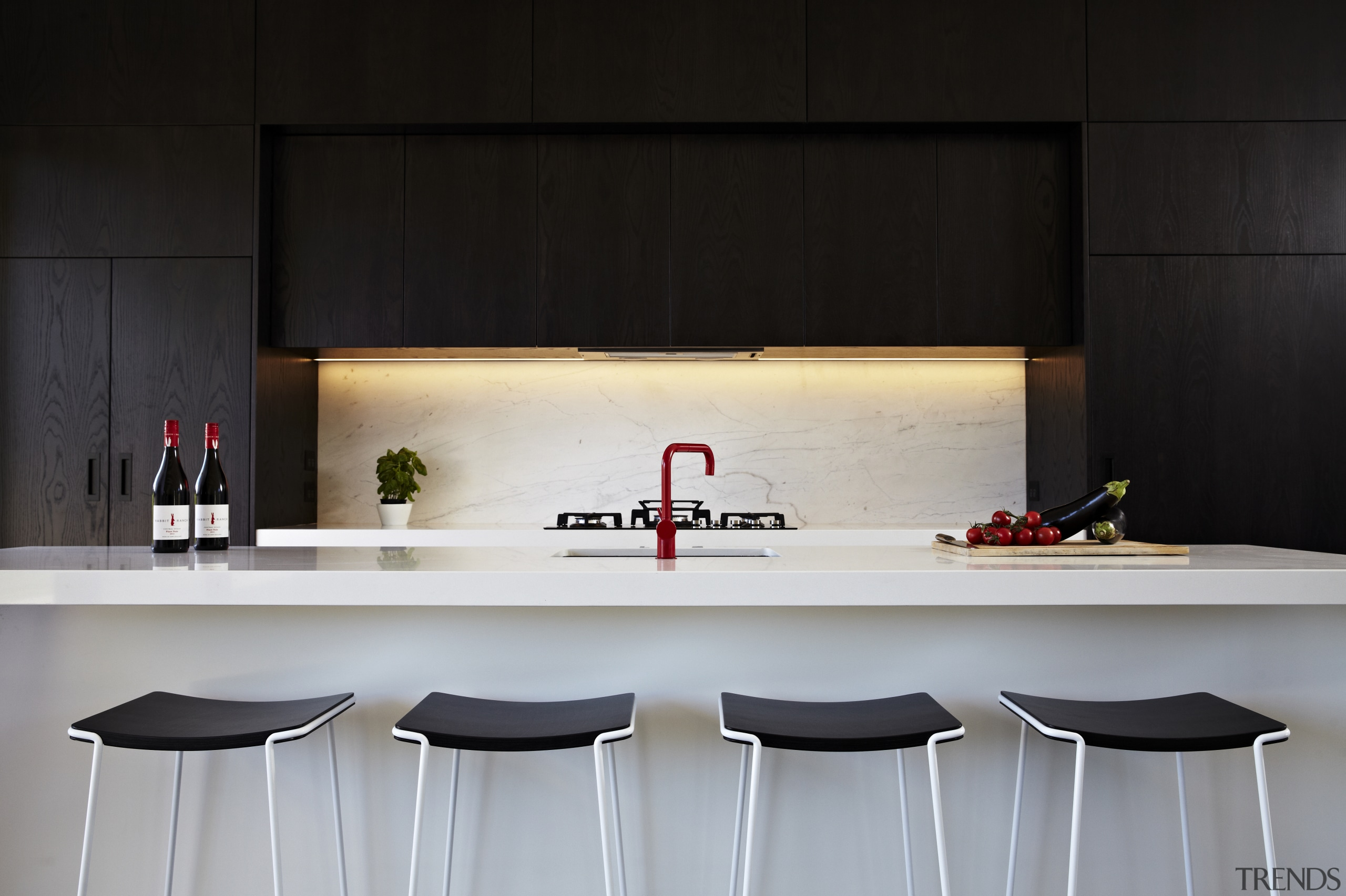 Architect Evelyn McNamara specified dark-stained American oak and countertop, furniture, interior design, kitchen, table, black, gray