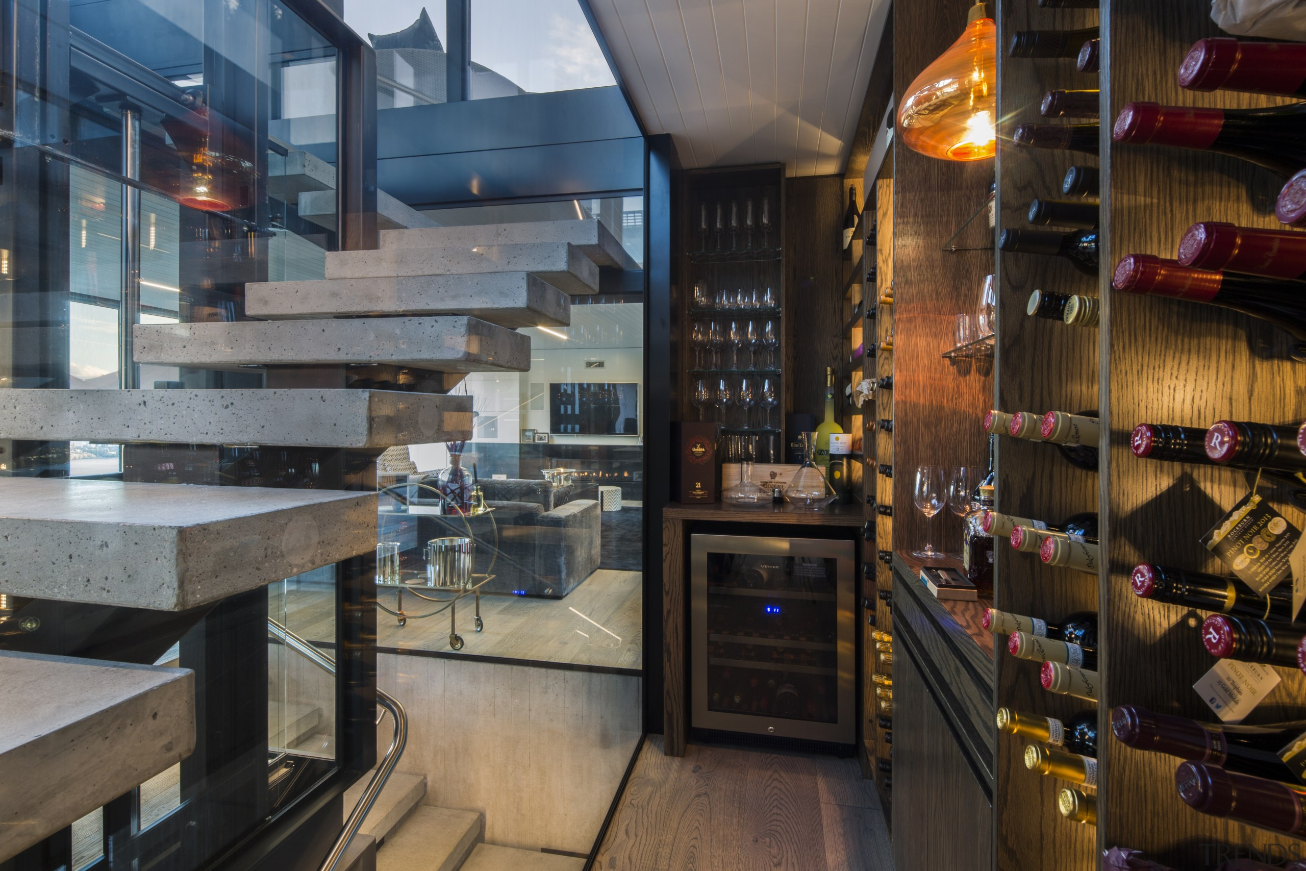 For this high-end residence, near invisible glass walls interior design, house, home, Gary Todd ARCHITECTURE, wine cellar