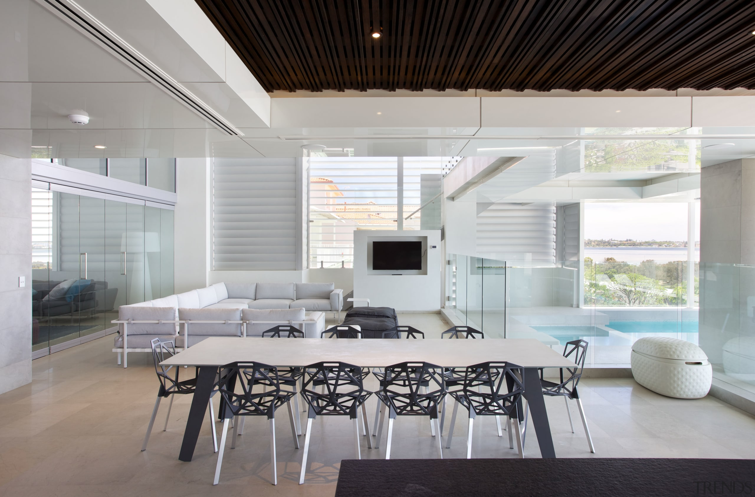 The mid-level of this three-storey house features a architecture, ceiling, daylighting, dining room, house, interior design, living room, real estate, table, gray