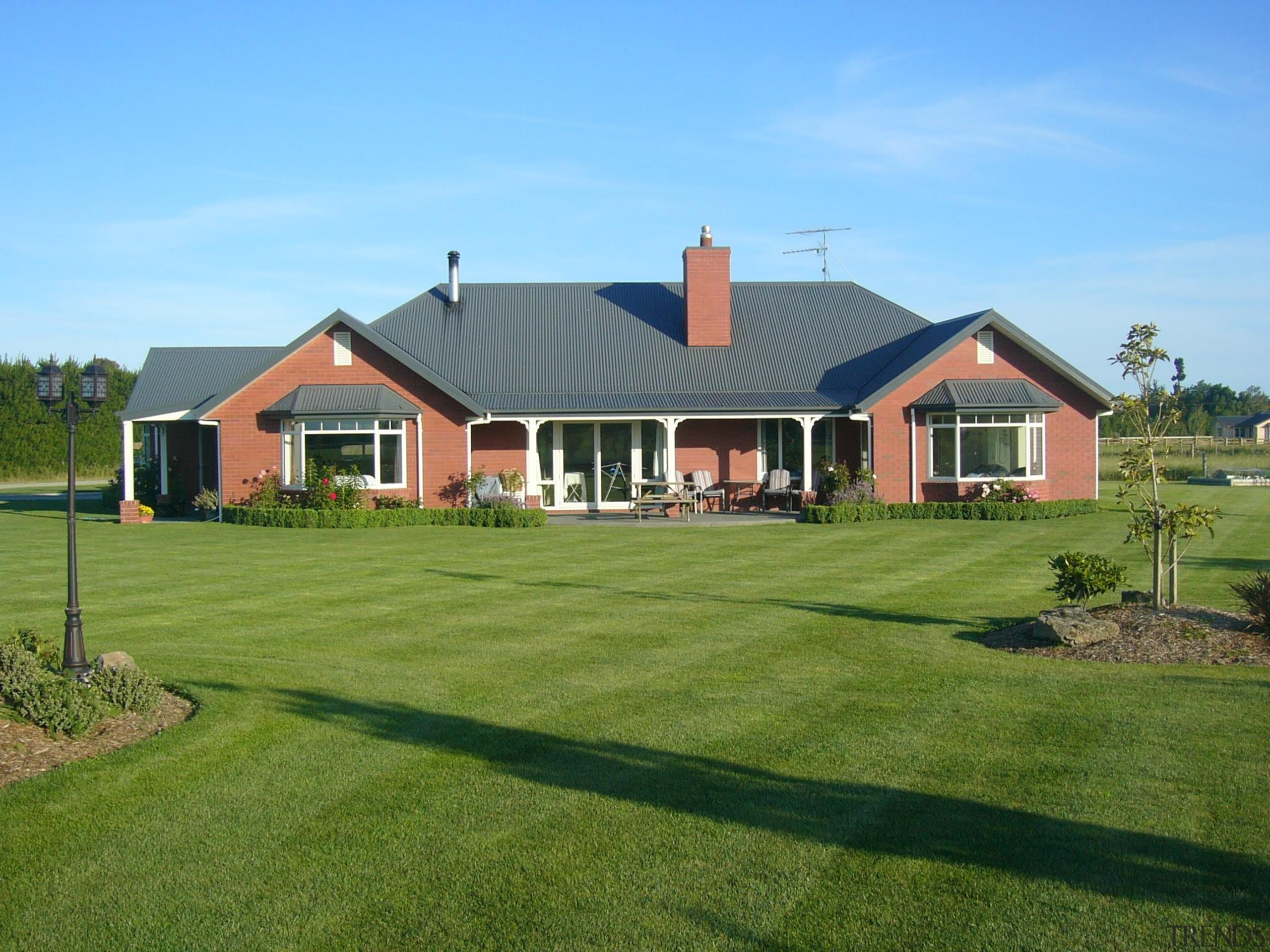 A Canterbury kiln fired red brick home of backyard, cottage, elevation, estate, facade, farm, farmhouse, golf club, grass, home, house, land lot, landscape, landscaping, lawn, plantation, property, real estate, residential area, roof, siding, suburb, yard, green, teal