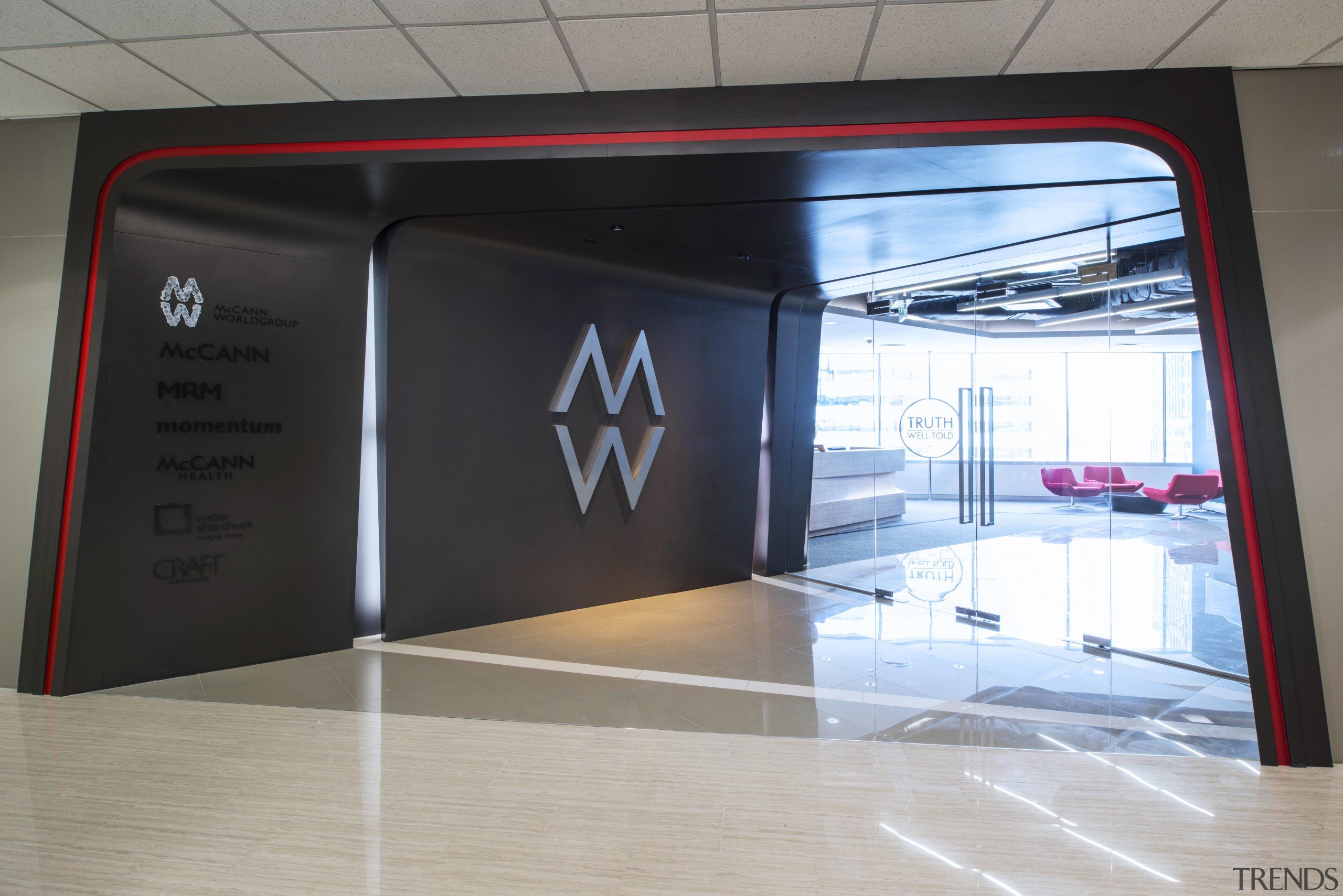 The entrance and reception area at McCann Worldgroups display device, product design, technology, gray, black