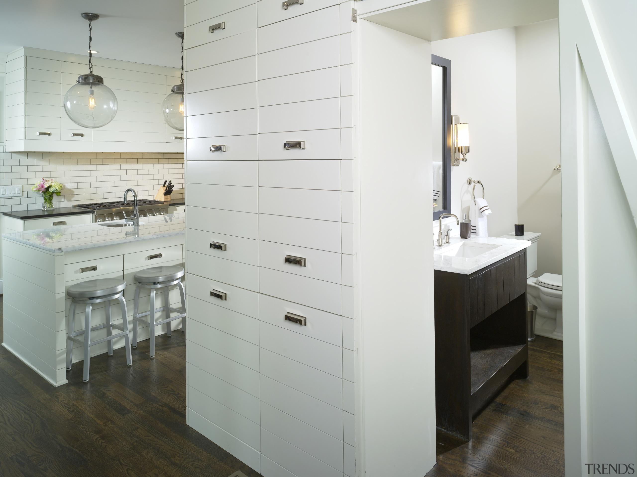 View of kitchen by Designer Willis Watts. Remodelled bathroom, bathroom accessory, bathroom cabinet, cabinetry, countertop, floor, flooring, home, interior design, kitchen, room, sink, gray, white
