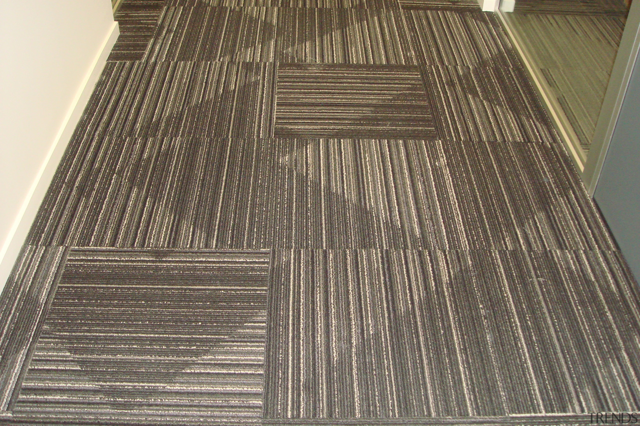 Durable, good-looking carpet tiles for commercial use daylighting, floor, flooring, hardwood, laminate flooring, line, wood, wood flooring, wood stain, gray, brown