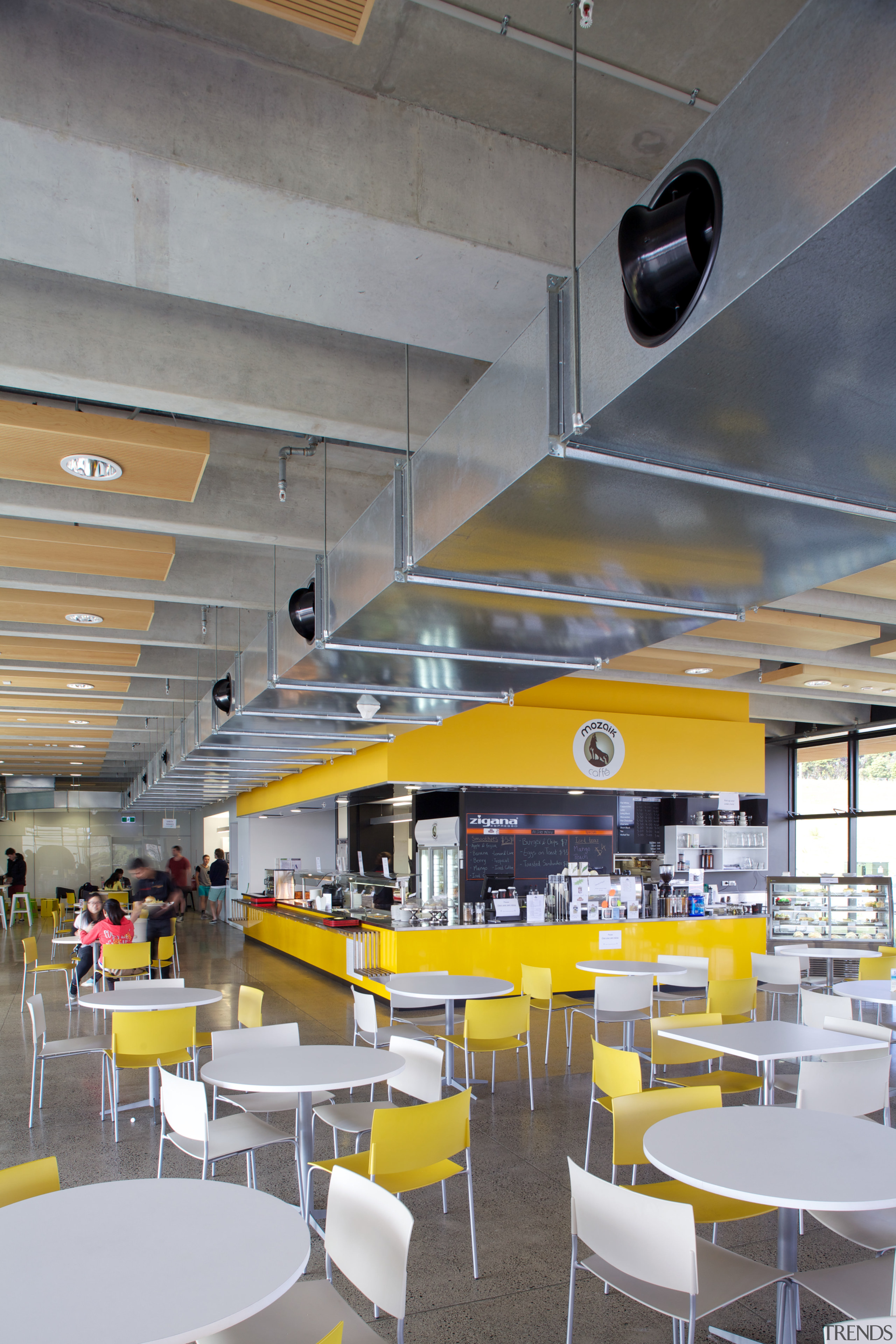 The clean-lined architecure of the facility is matched architecture, cafeteria, ceiling, interior design, yellow, gray
