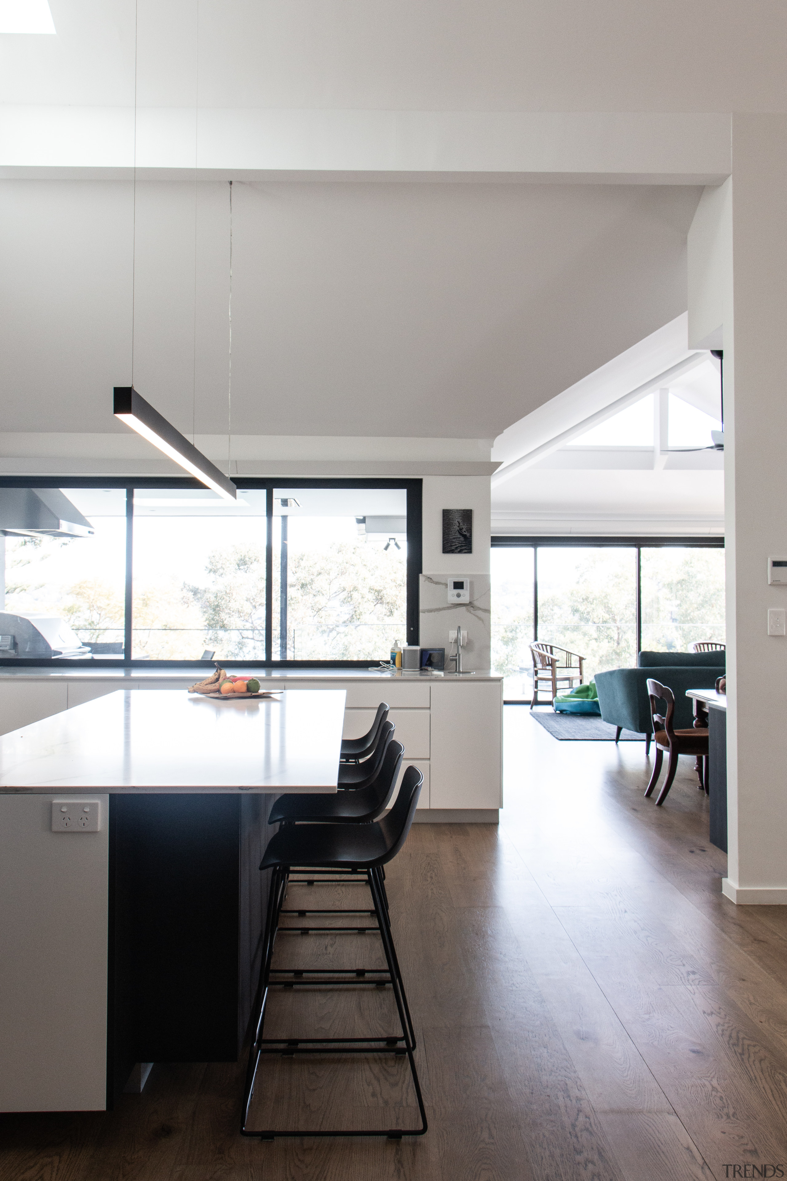 A pelmet conceals dedicated lighting above the servery gray