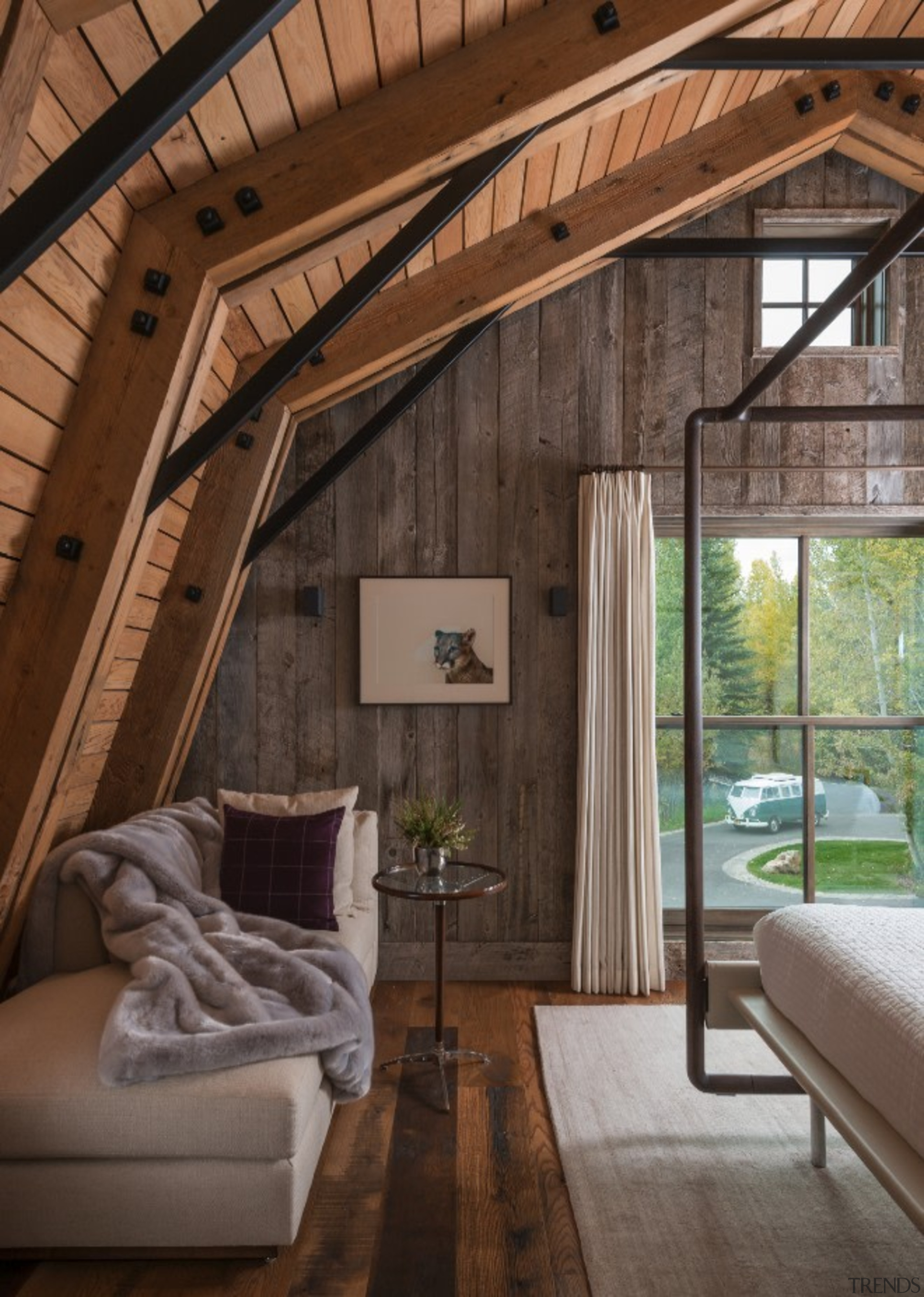 The bedroom looks out onto the driveway - architecture, beam, ceiling, home, house, interior design, living room, room, window, wood, brown