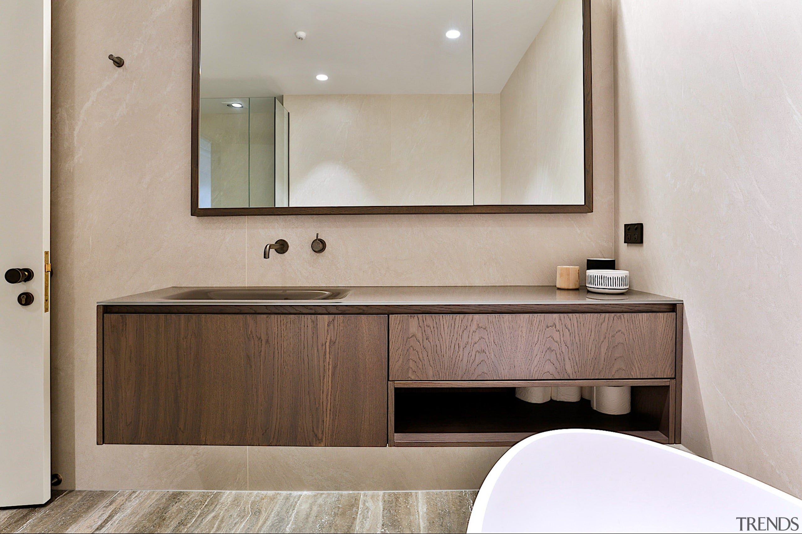 This bathroom's vanity combines a Falper glass benchtop