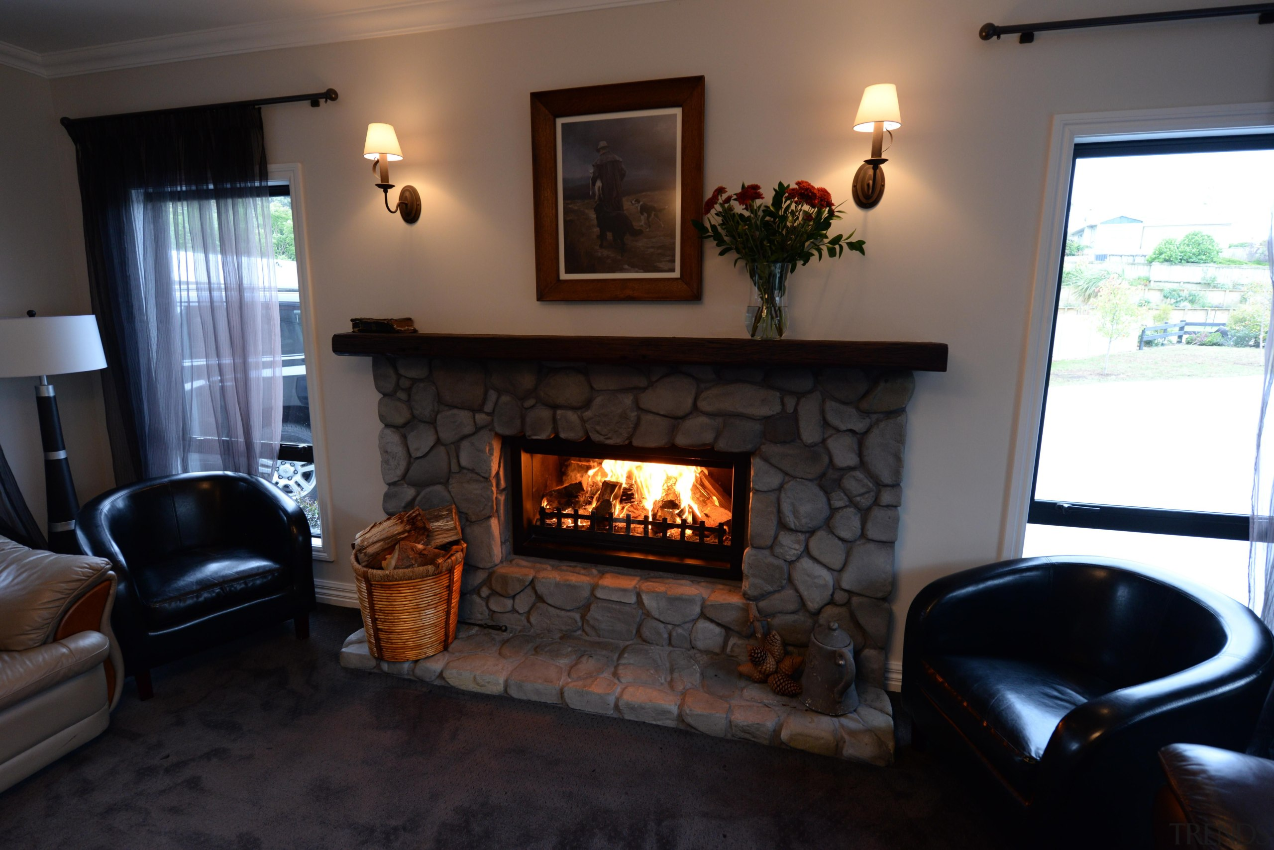 Feature river stone open fire surroundSince the early fireplace, hearth, home, house, interior design, living room, real estate, room, wood burning stove, black