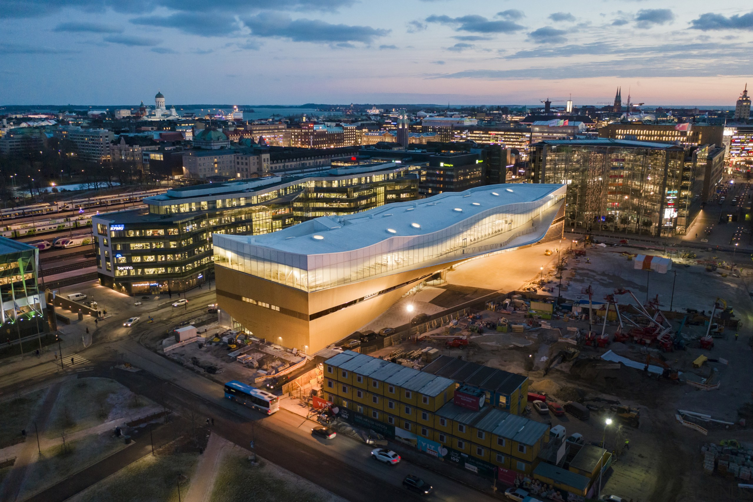 The Helsinki library at night shows off it aerial photography, architecture, arena, bird's-eye view, building, city, cityscape, downtown, human settlement, metropolis, metropolitan area, mixed-use, night, photography, roof, sky, sport venue, transport, urban area, black