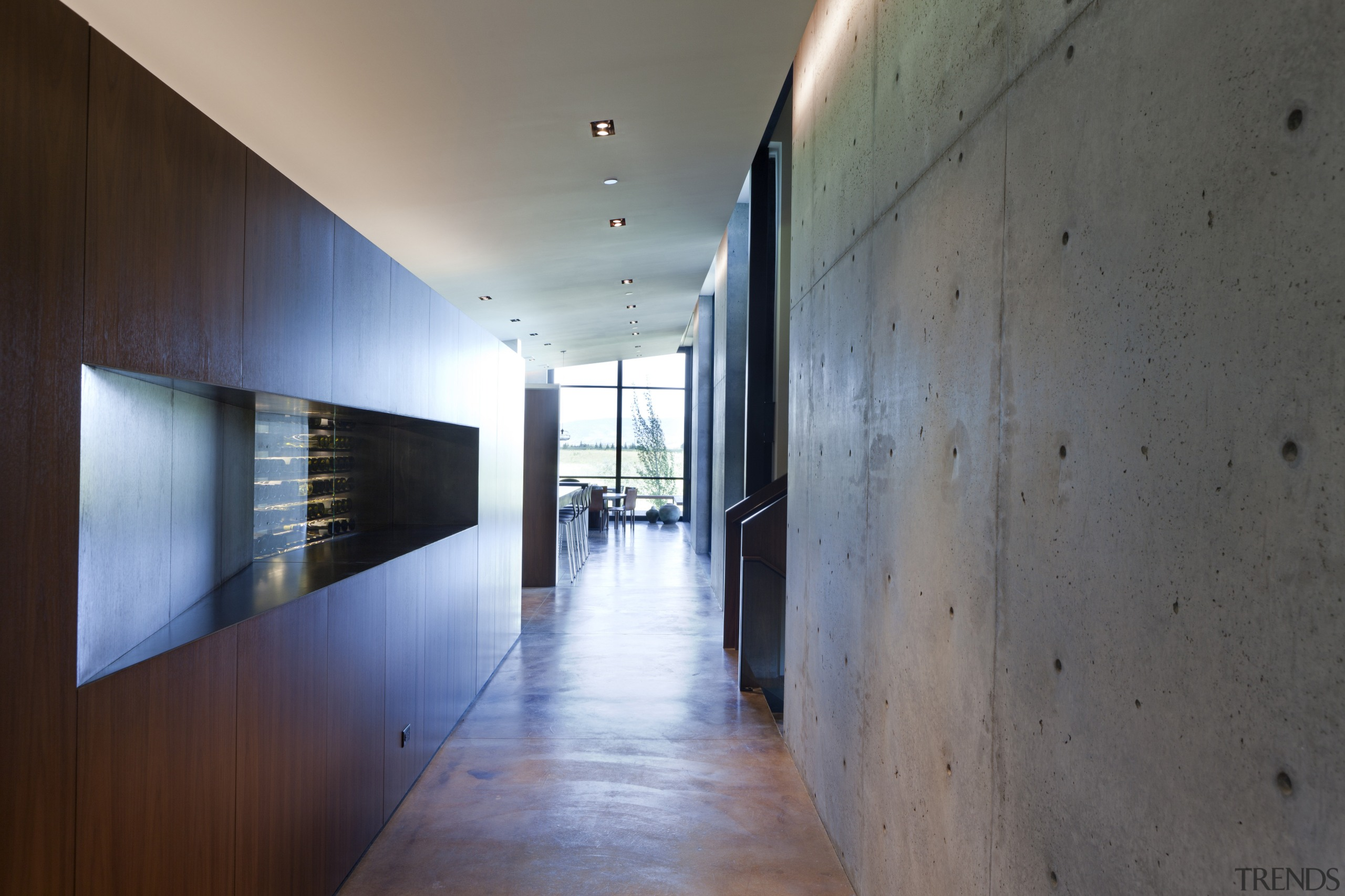 The walnut cabinetry divides the interior  living architecture, daylighting, house, interior design, lobby, wood, gray