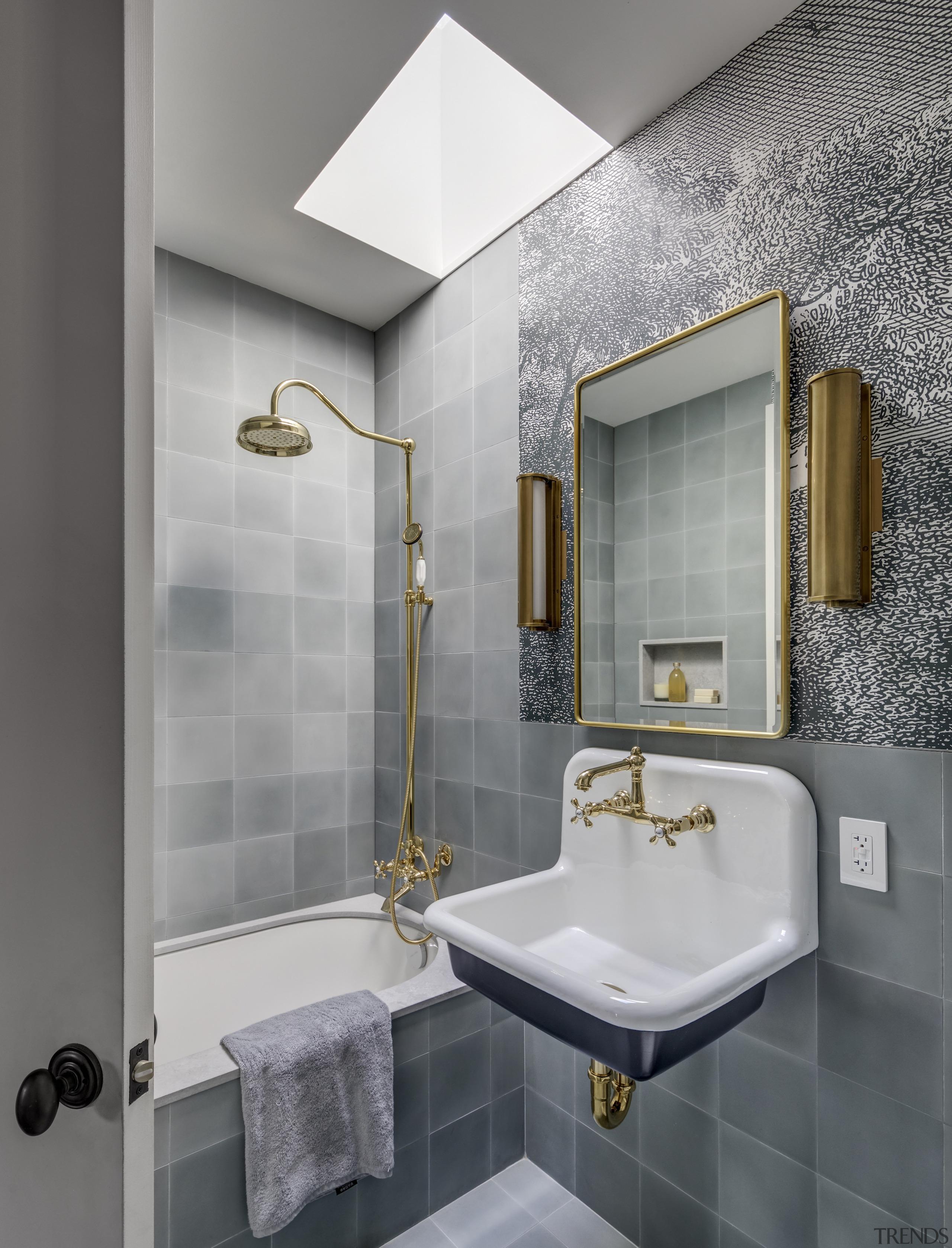 The third floor bathroom features an exotic wallpaper
