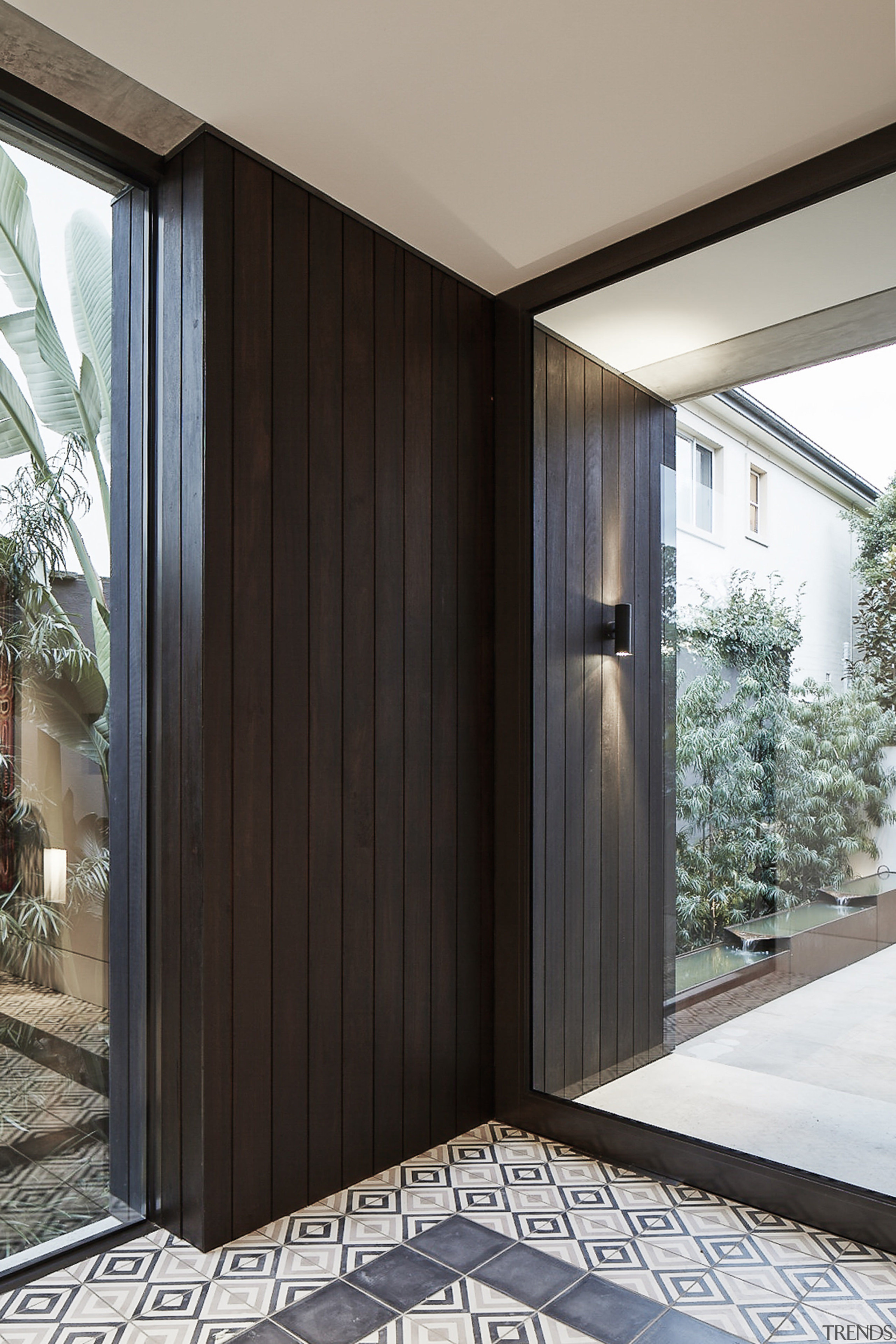 Repositioning the front door to the middle at architecture, door, facade, house, wood, black, gray