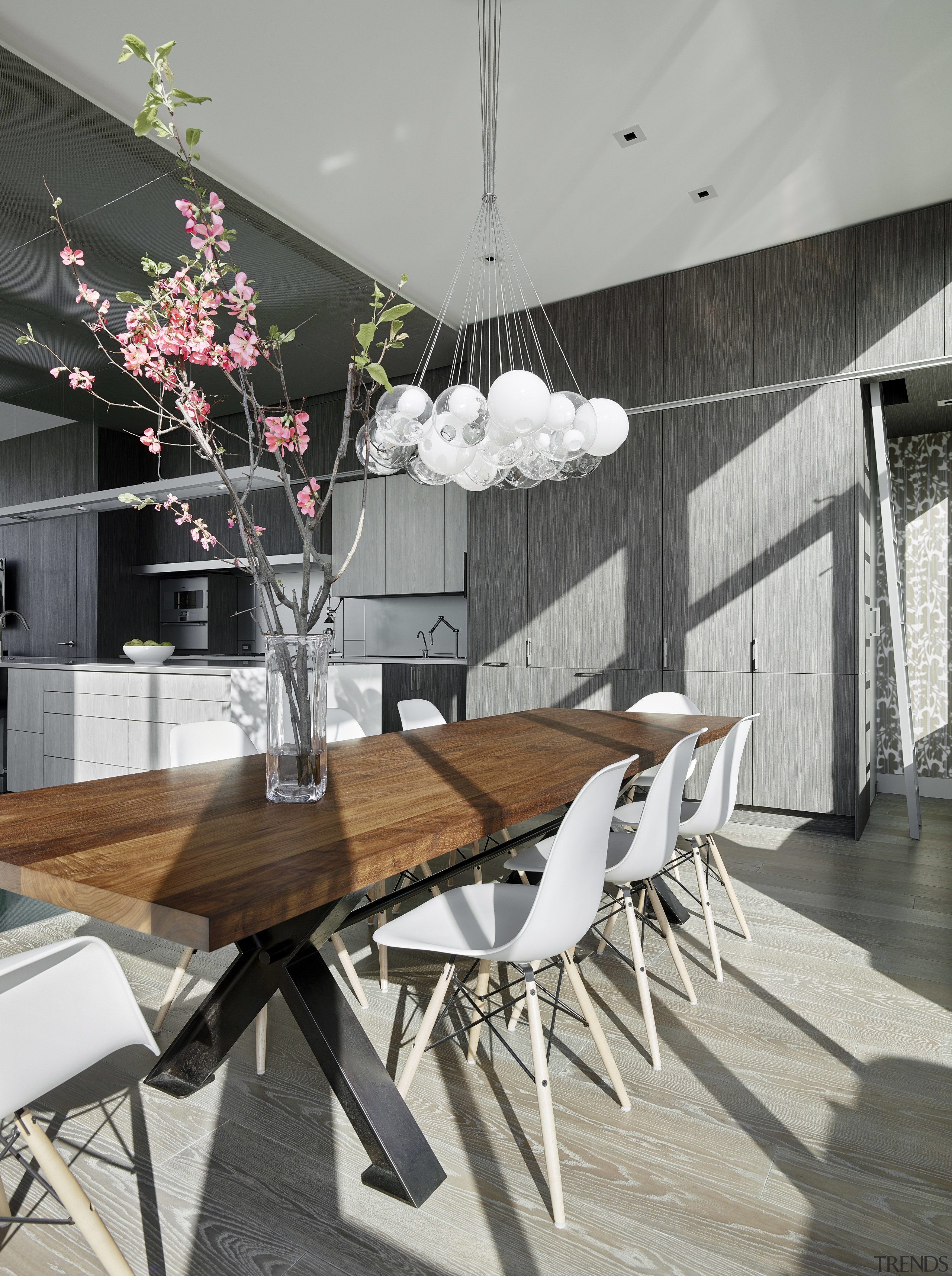 Cabinets beside the dining area hide a powder architecture, chair, dining room, furniture, home, house, interior design, table, gray