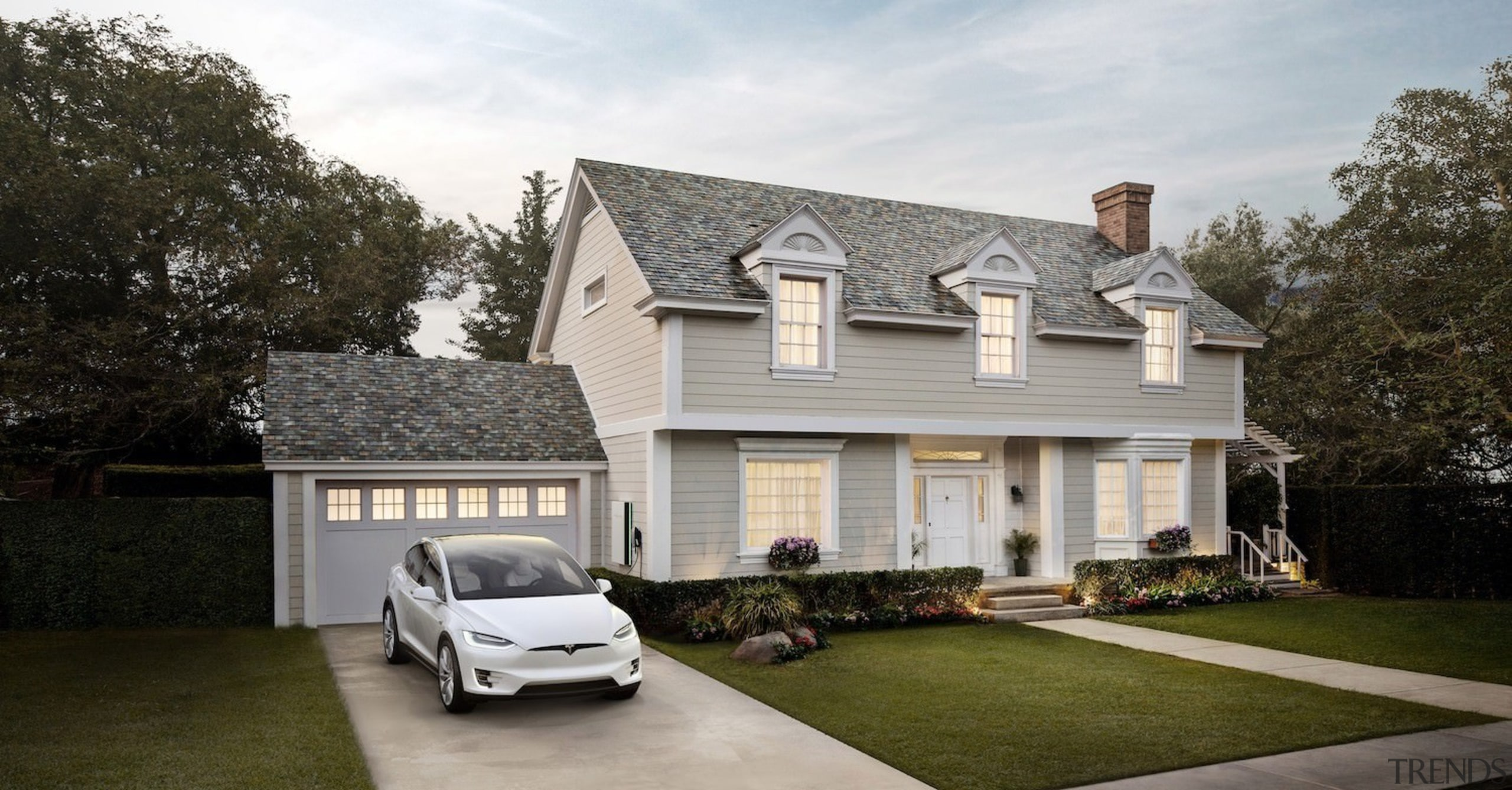 A home with Tesla Solar Roof tiles installed building, cottage, elevation, estate, facade, family car, home, house, luxury vehicle, property, real estate, residential area, roof, siding, suburb, window, gray, brown