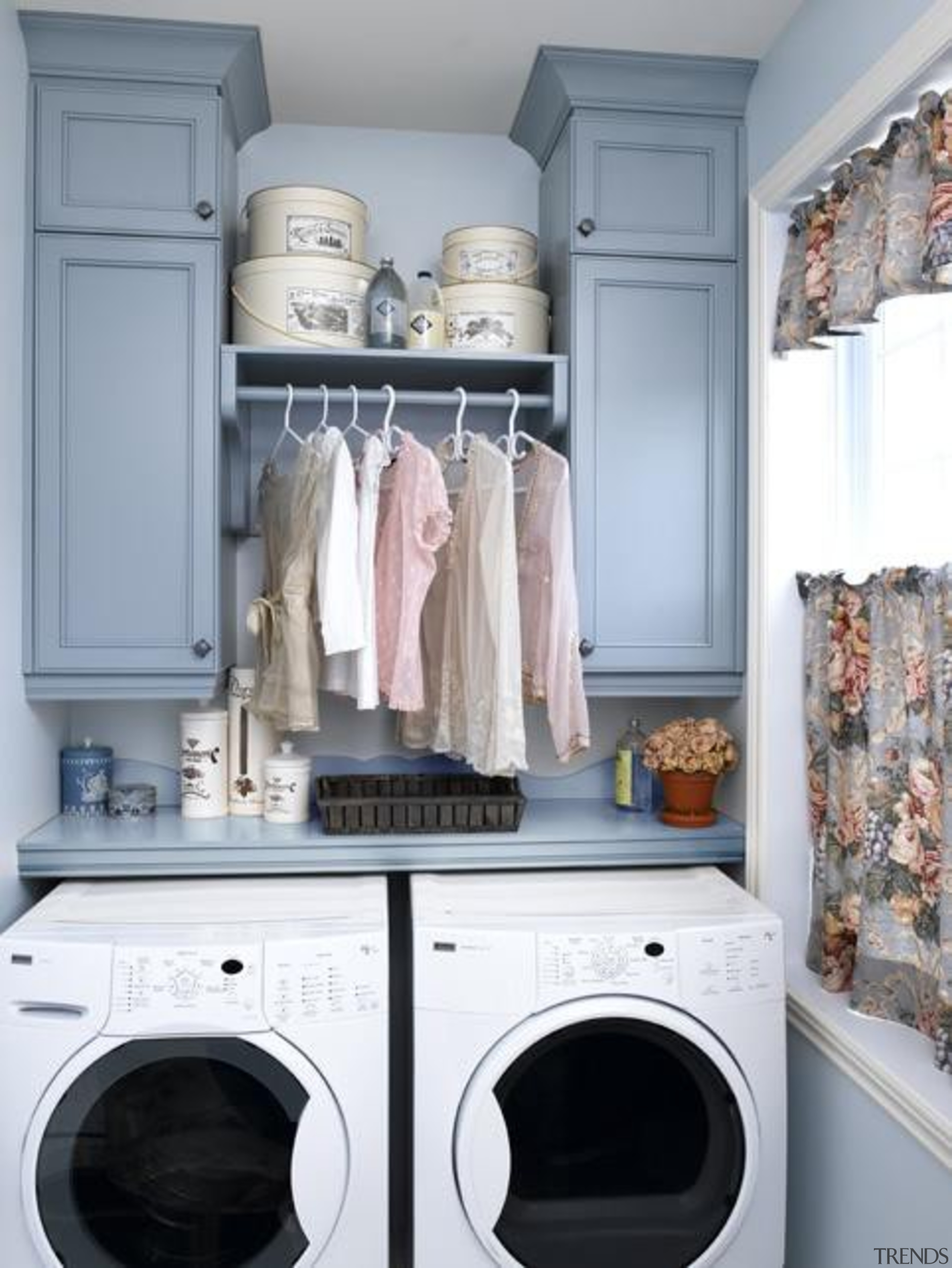 Utilitarian spaces such as laundry rooms and mudrooms closet, clothes dryer, laundry, laundry room, room, shelf, gray
