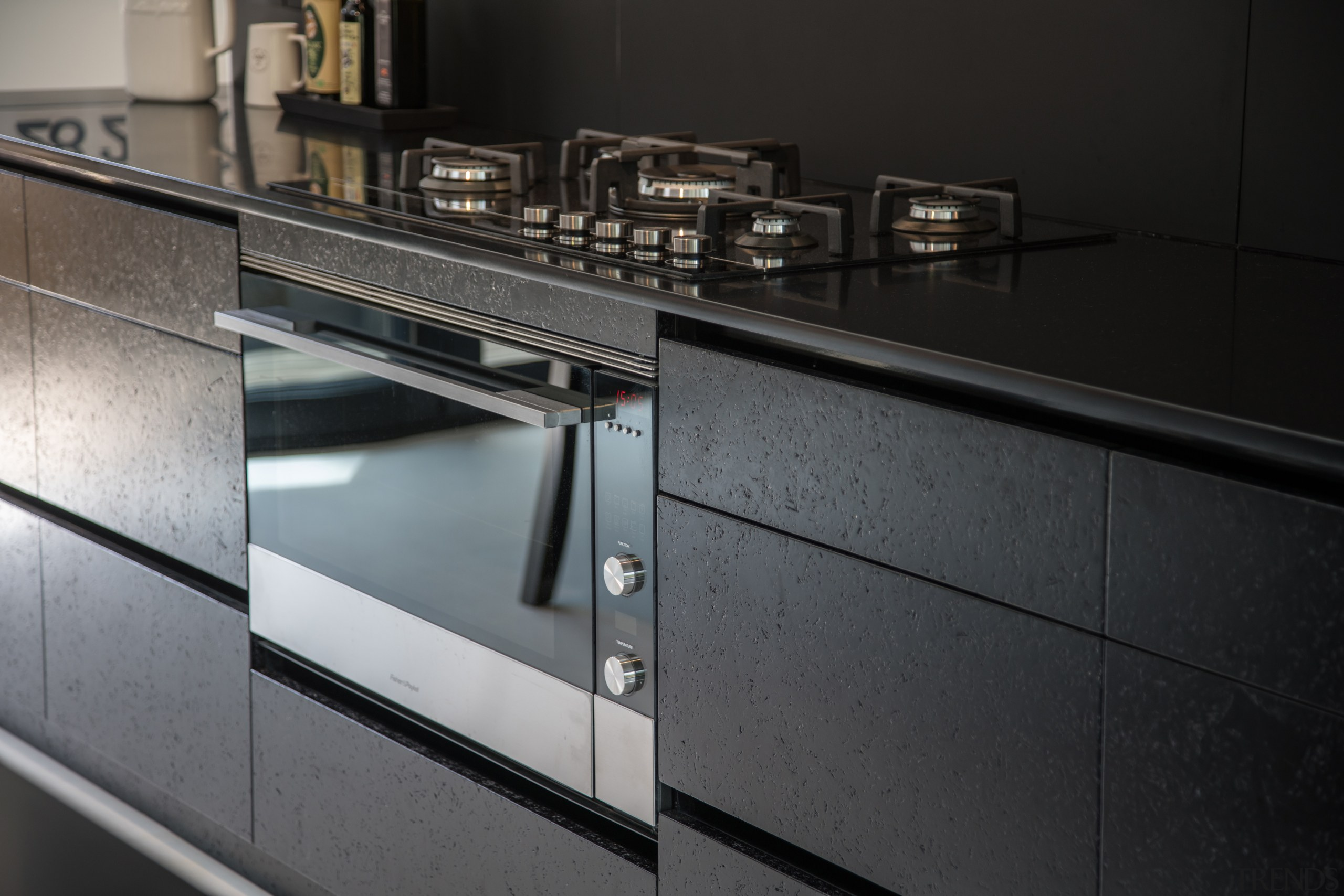 Seen up close, the textural nature of the countertop, furniture, glass, kitchen, major appliance, product design, black, gray