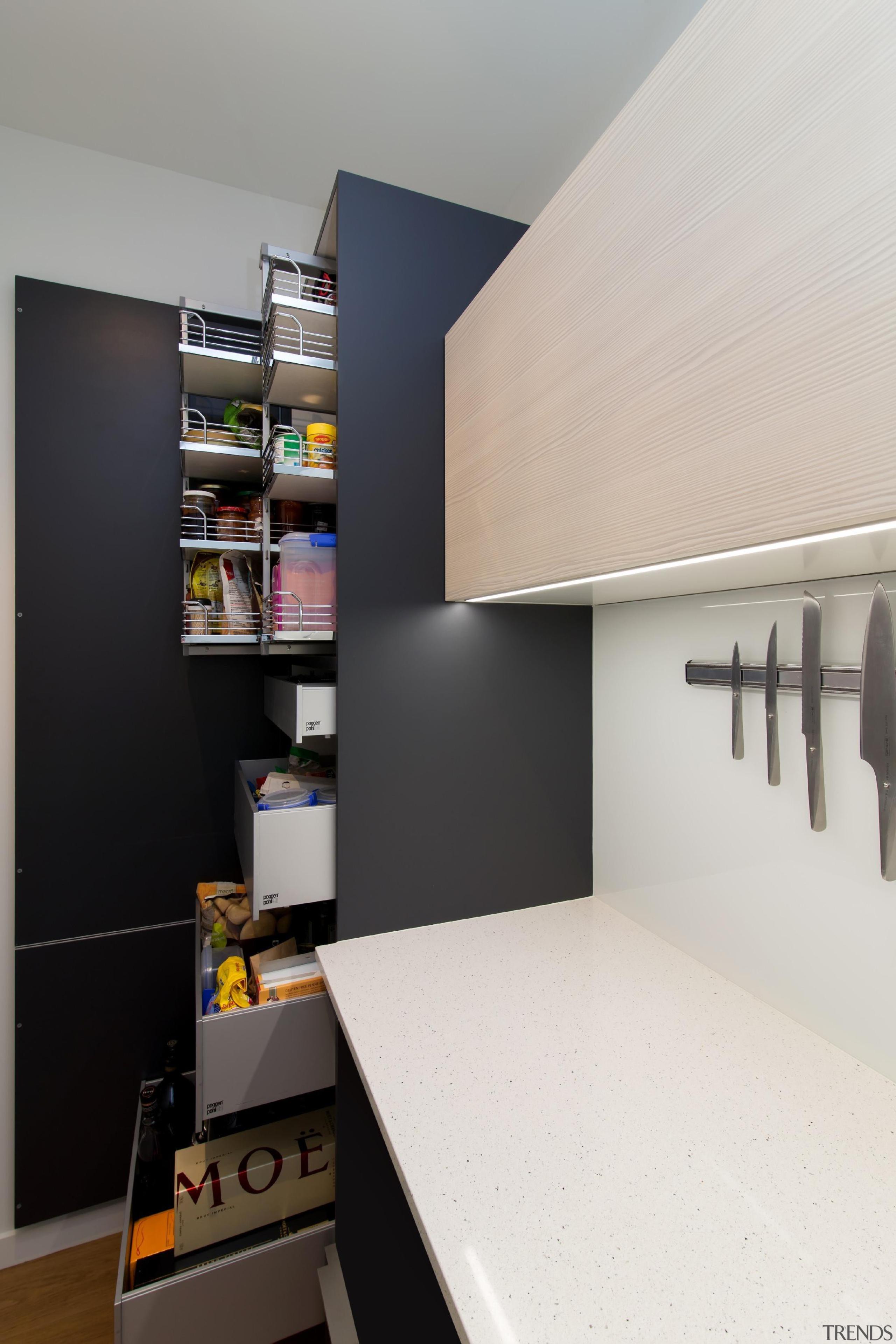 Full shot of the pantry in the sculleryFor furniture, interior design, product design, room, shelf, shelving, white, black