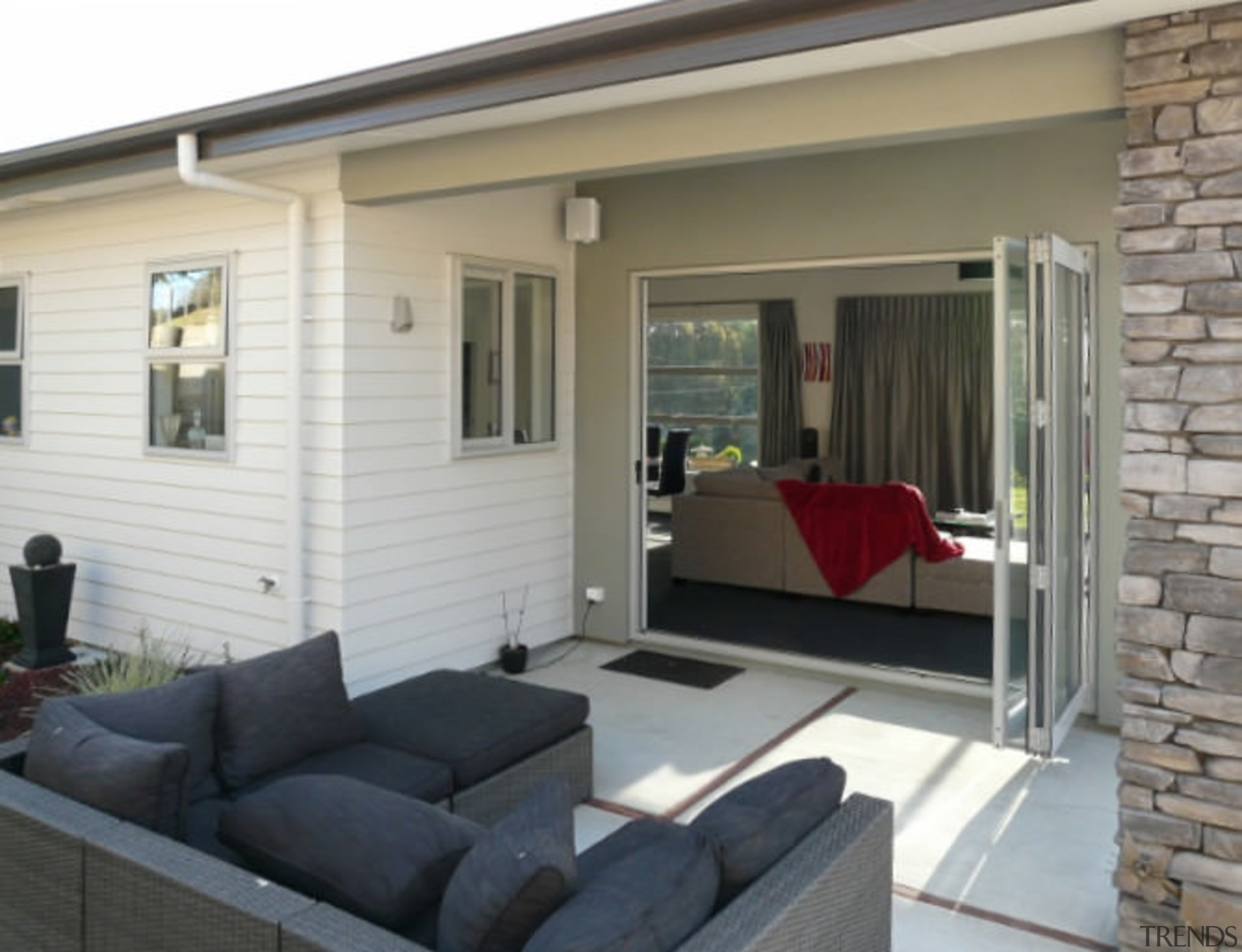 As this house shows, low-upkeep Palliside cladding never door, home, house, interior design, living room, porch, property, real estate, siding, window, gray